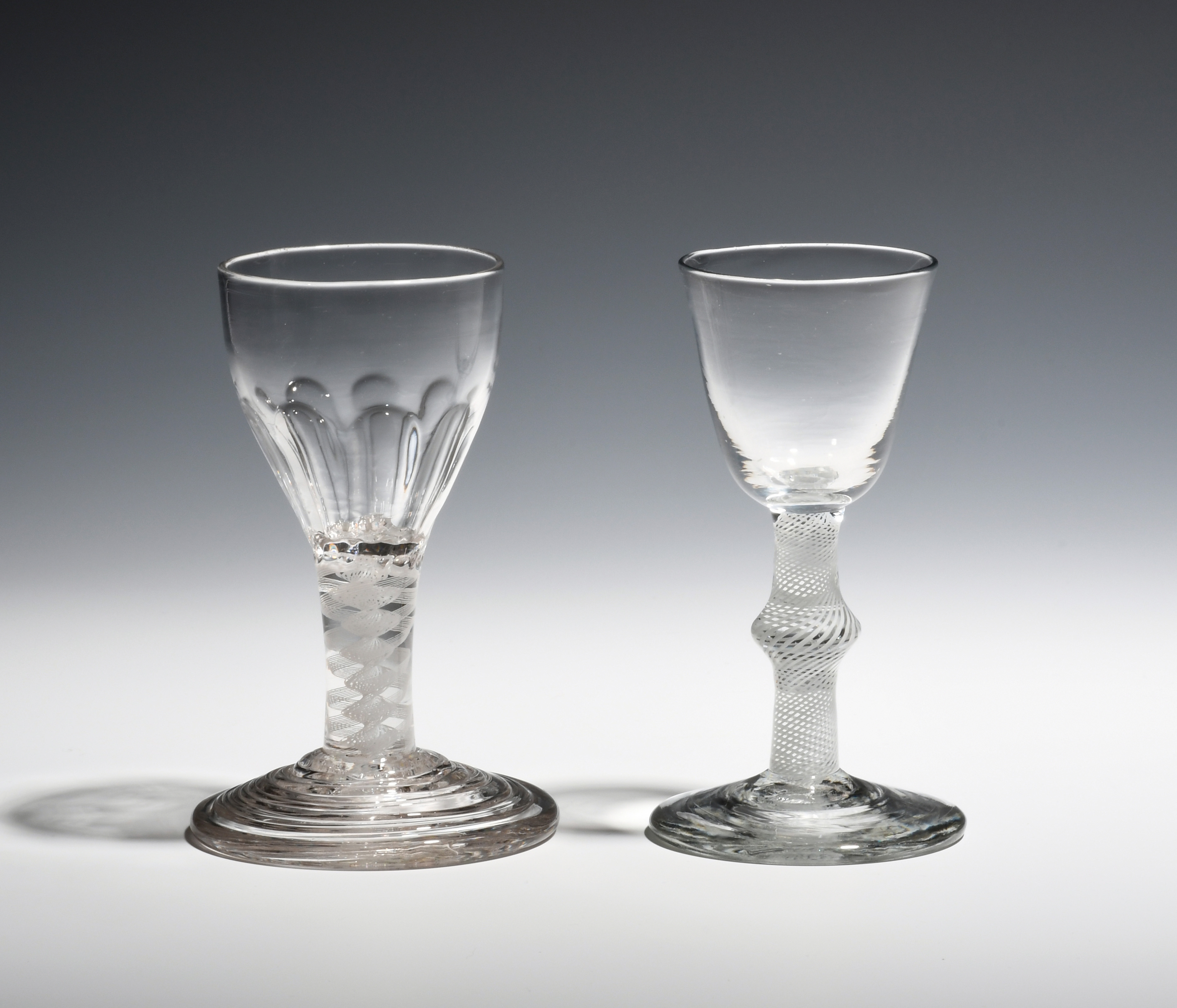 A small wine glass and a dram glass c.1760-70, the wine with a round funnel bowl on an opaque