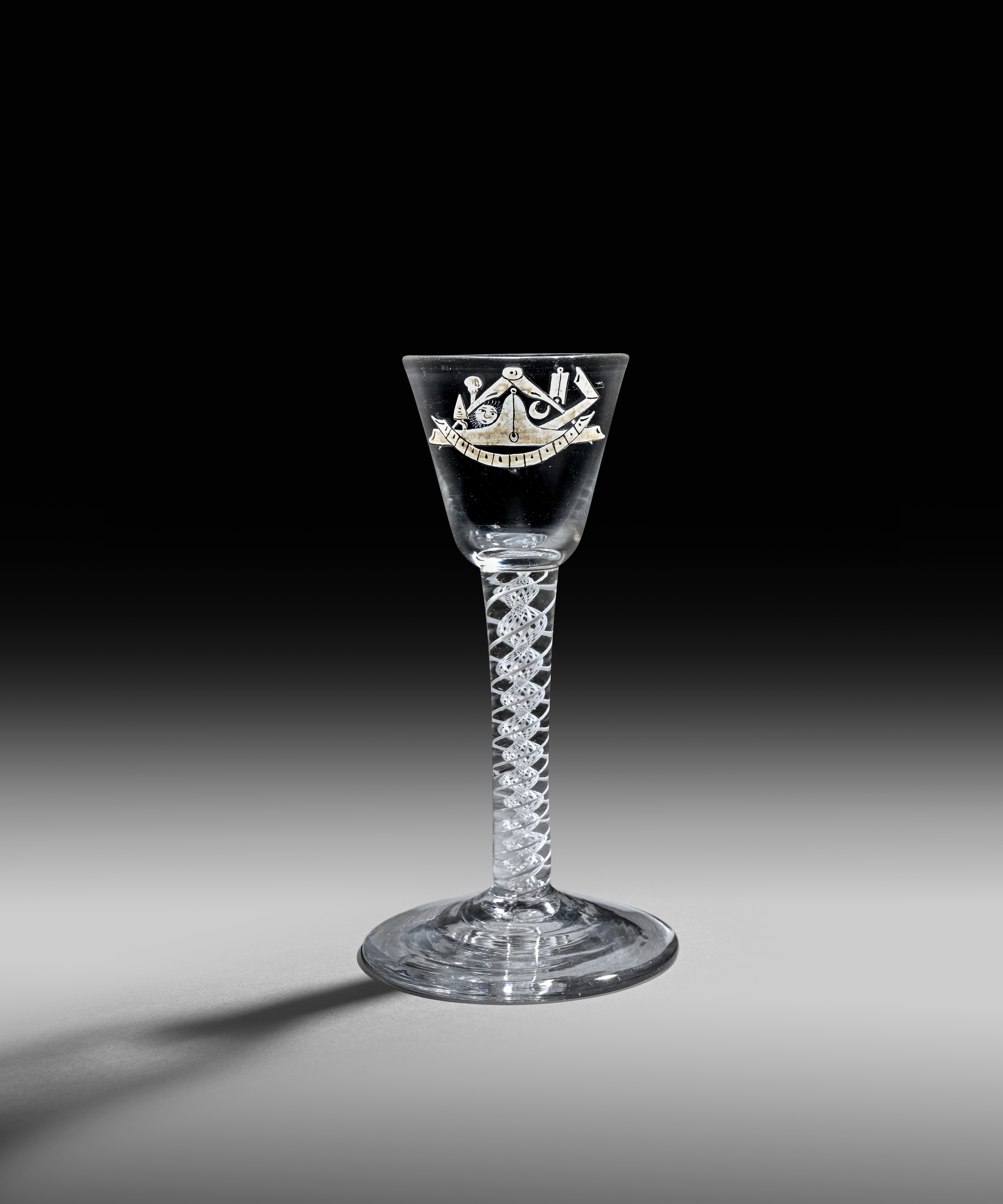 A rare enamelled wine glass c.1765, possibly by Anthony Taylor, the round funnel bowl enamelled in