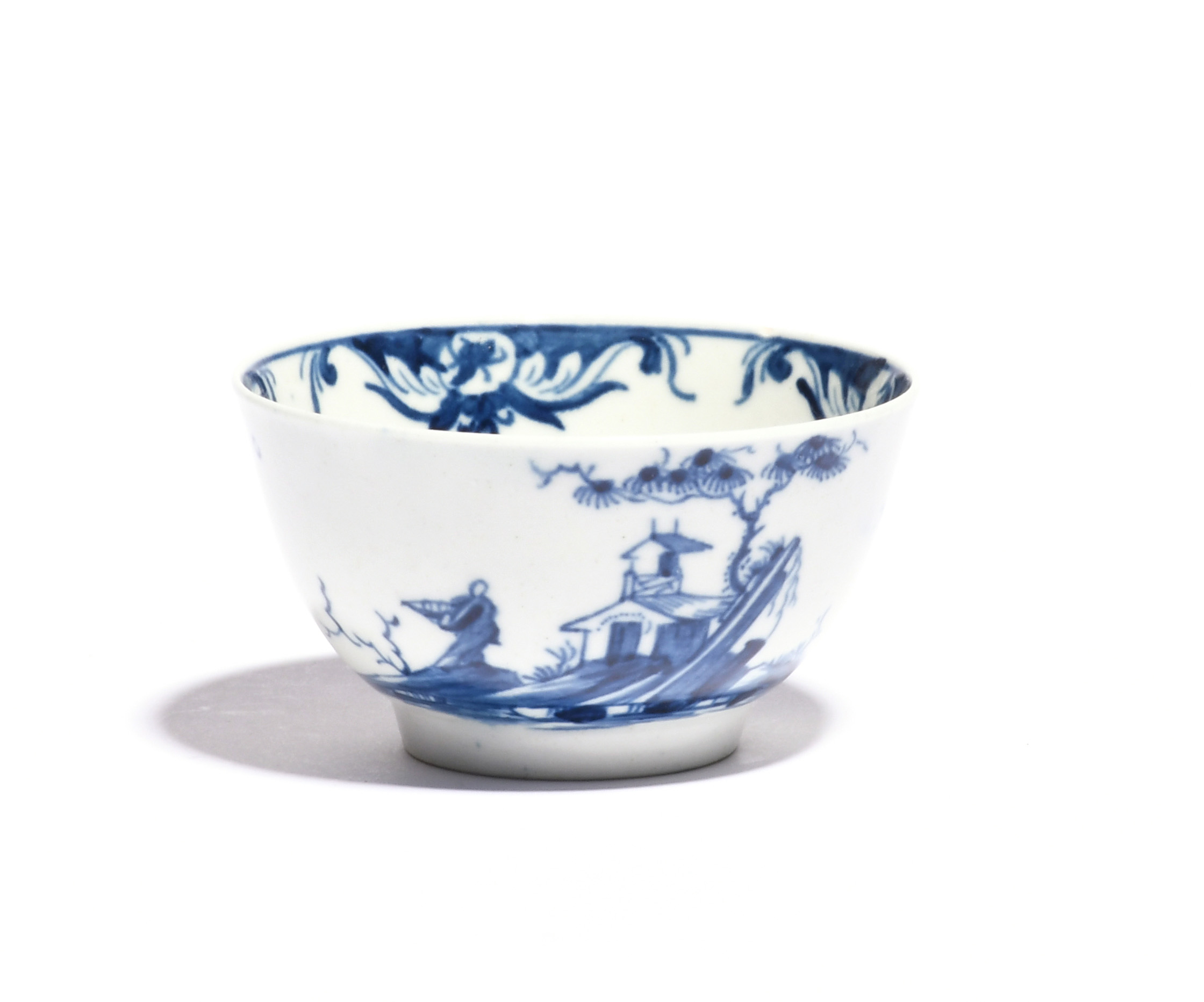 A rare Worcester blue and white teabowl c.1758, painted with the Diagonal Rock Island pattern, a