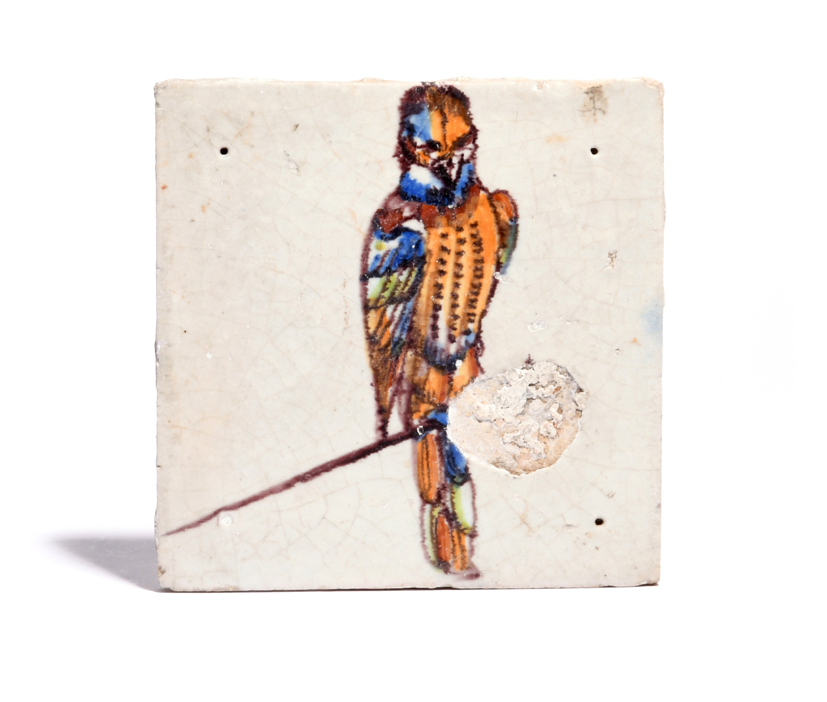 A Gouda Delft 'bird on a nail' tile (spijkertegel) c.1640-60, decorated in polychrome enamels with a