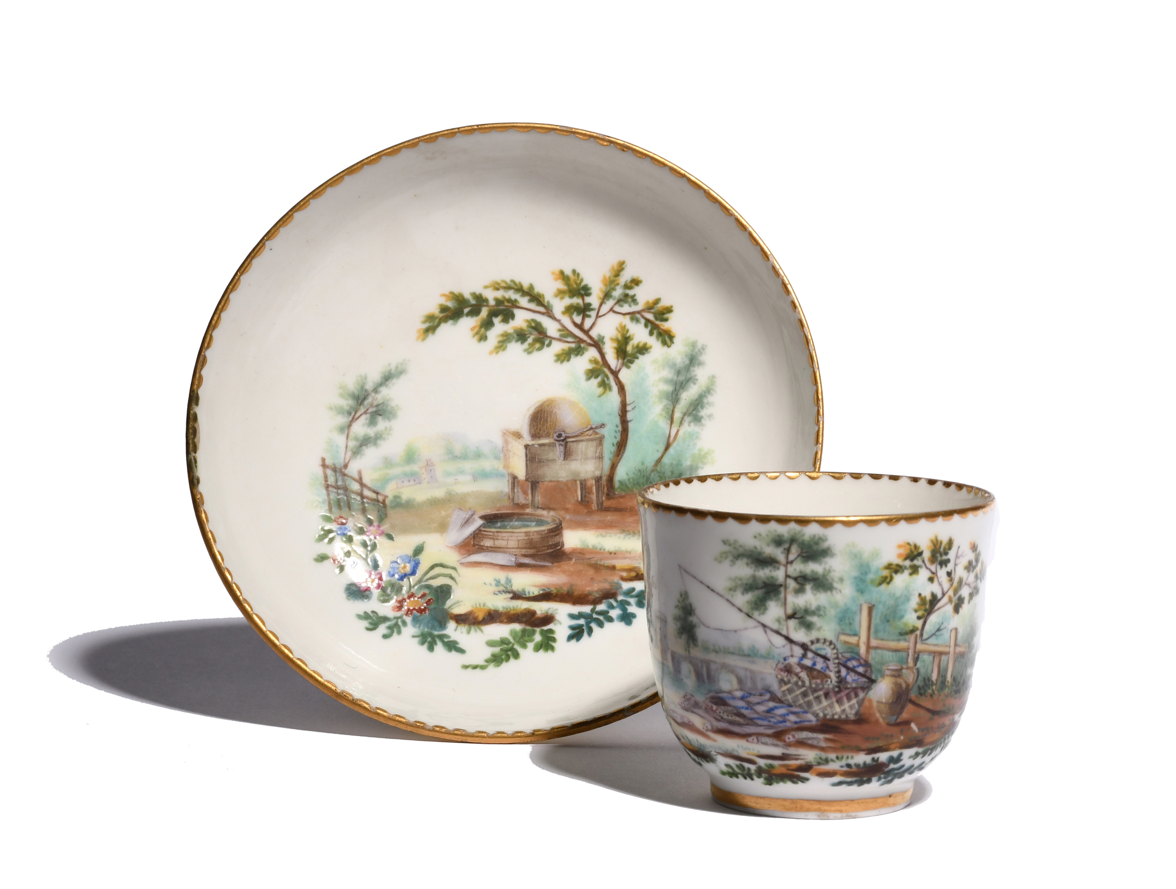 A Sèvres coffee cup and saucer c.1760, painted perhaps by André Vincent Vielliard, the cup painted