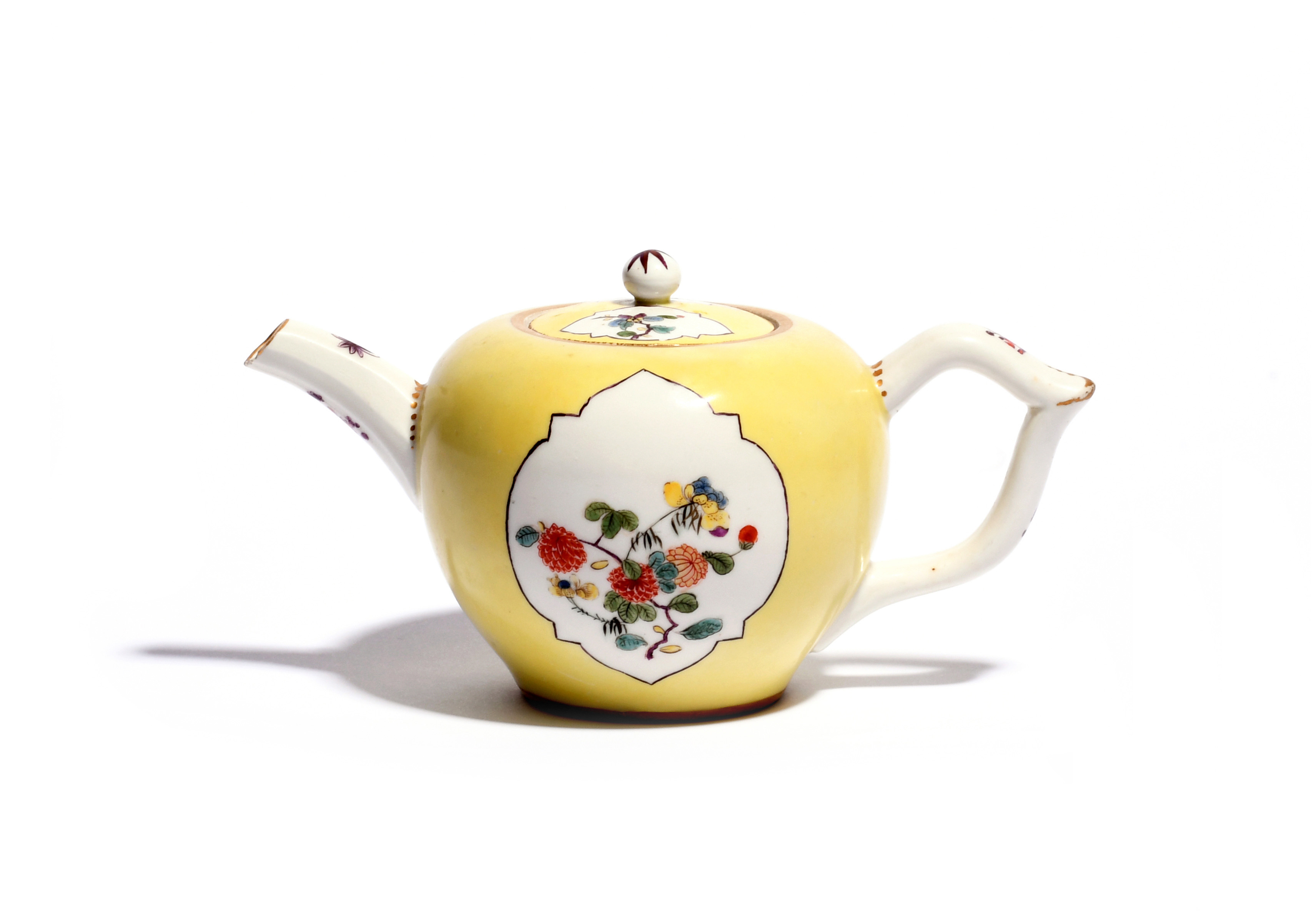A Meissen teapot and cover c.1735, painted in an extended Kakiemon palette with sprays of