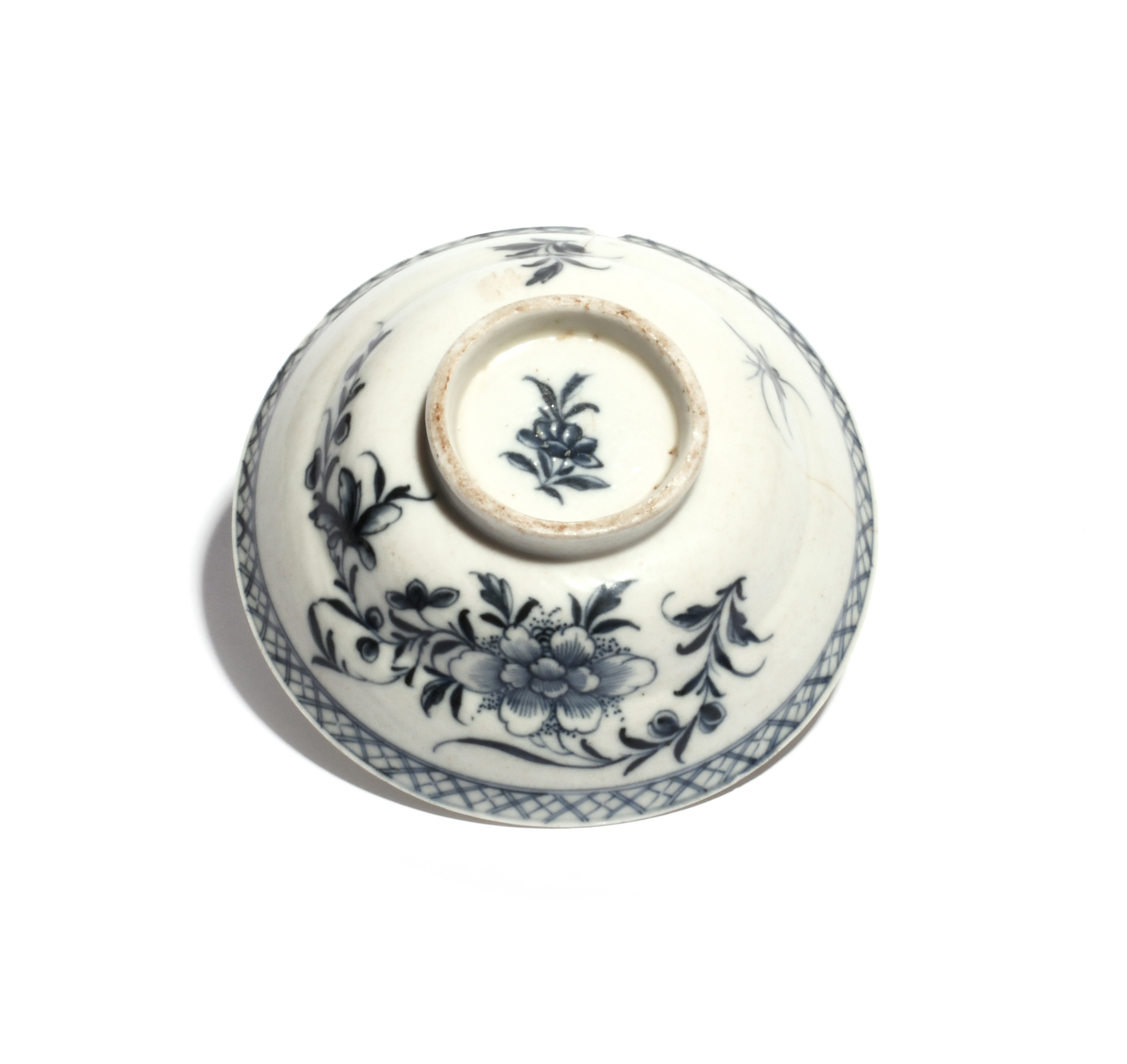 A rare Plymouth blue and white bowl cover c.1770, of ogee shape, painted in a dark blue with a spray