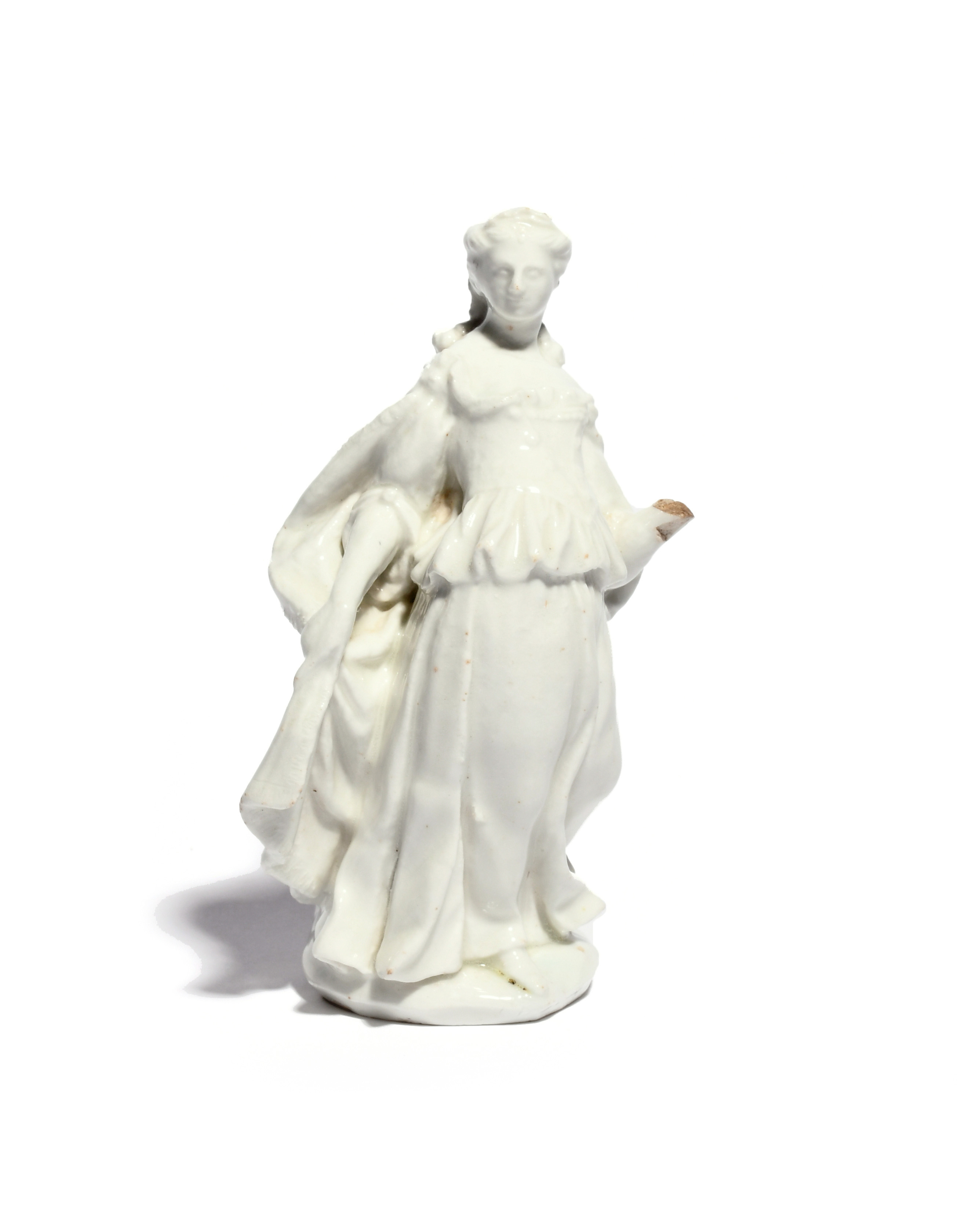 A white-glazed Bow Commedia dell'Arte figure of Isabella c.1752-55, standing in a theatrical pose
