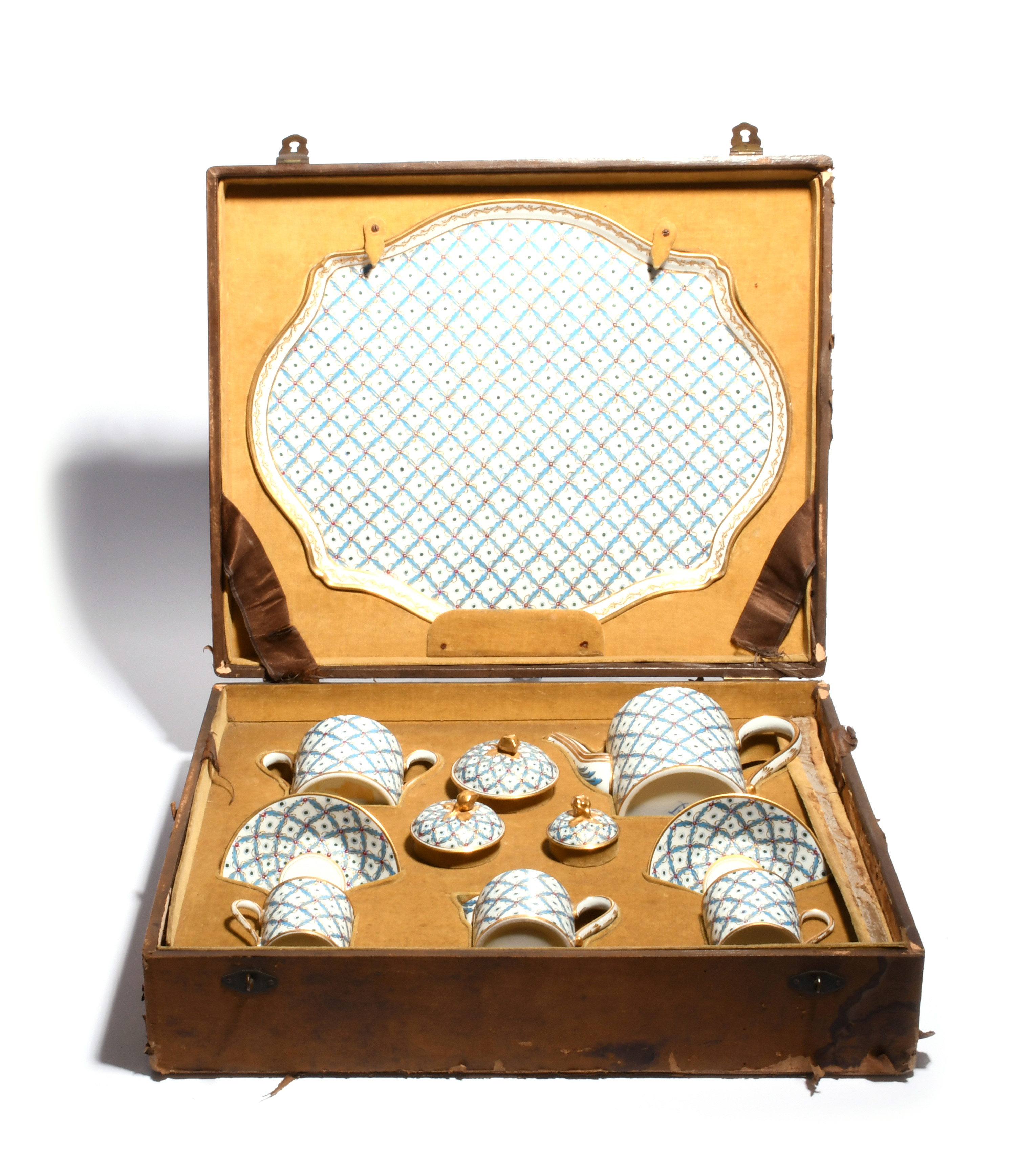 A Sèvres-style cabaret set 19th century, richly decorated with a trellis leaf design in turquoise,