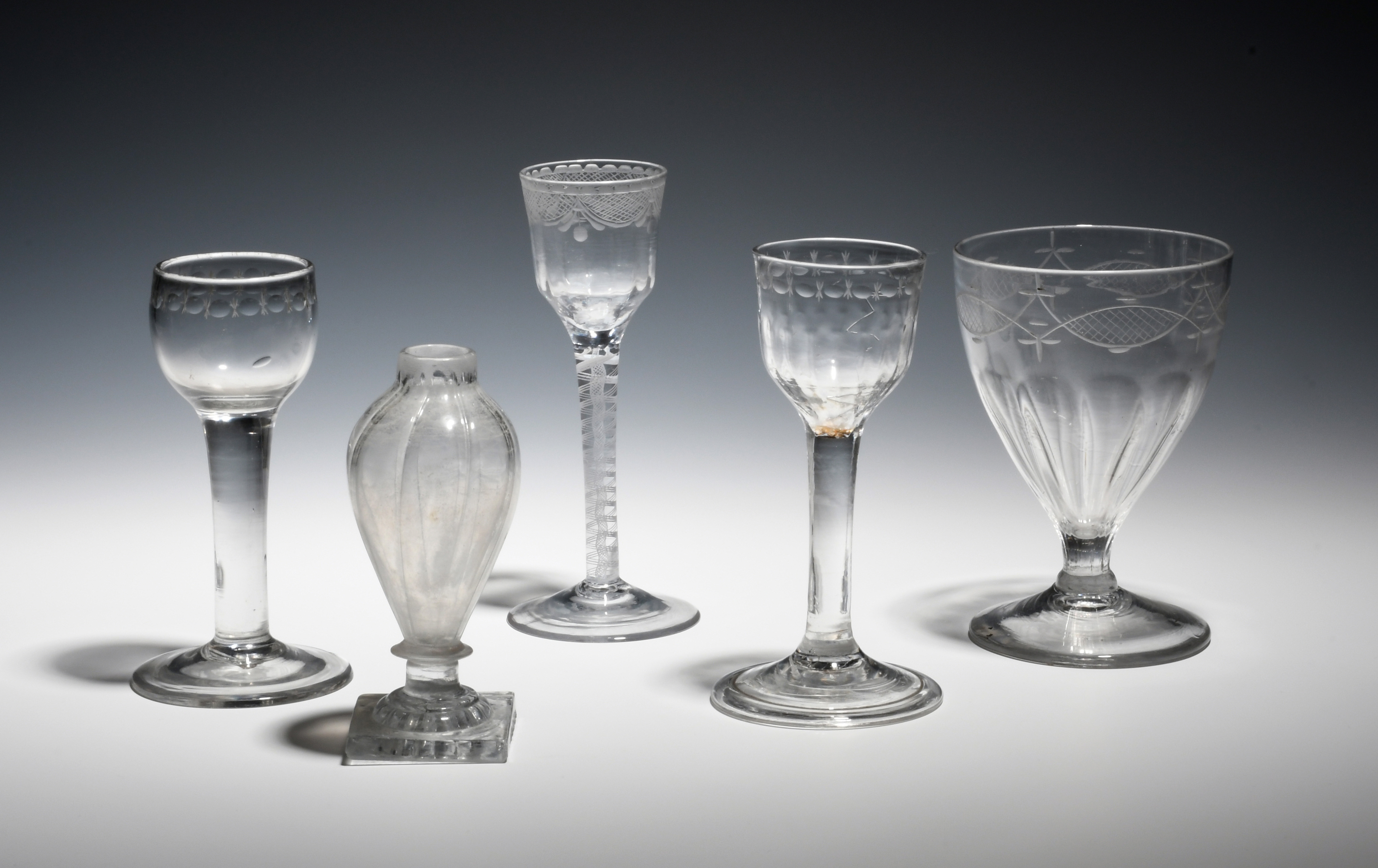 Four drinking glasses c.1770-1800, two small wines with polished circle borders, raised on plain