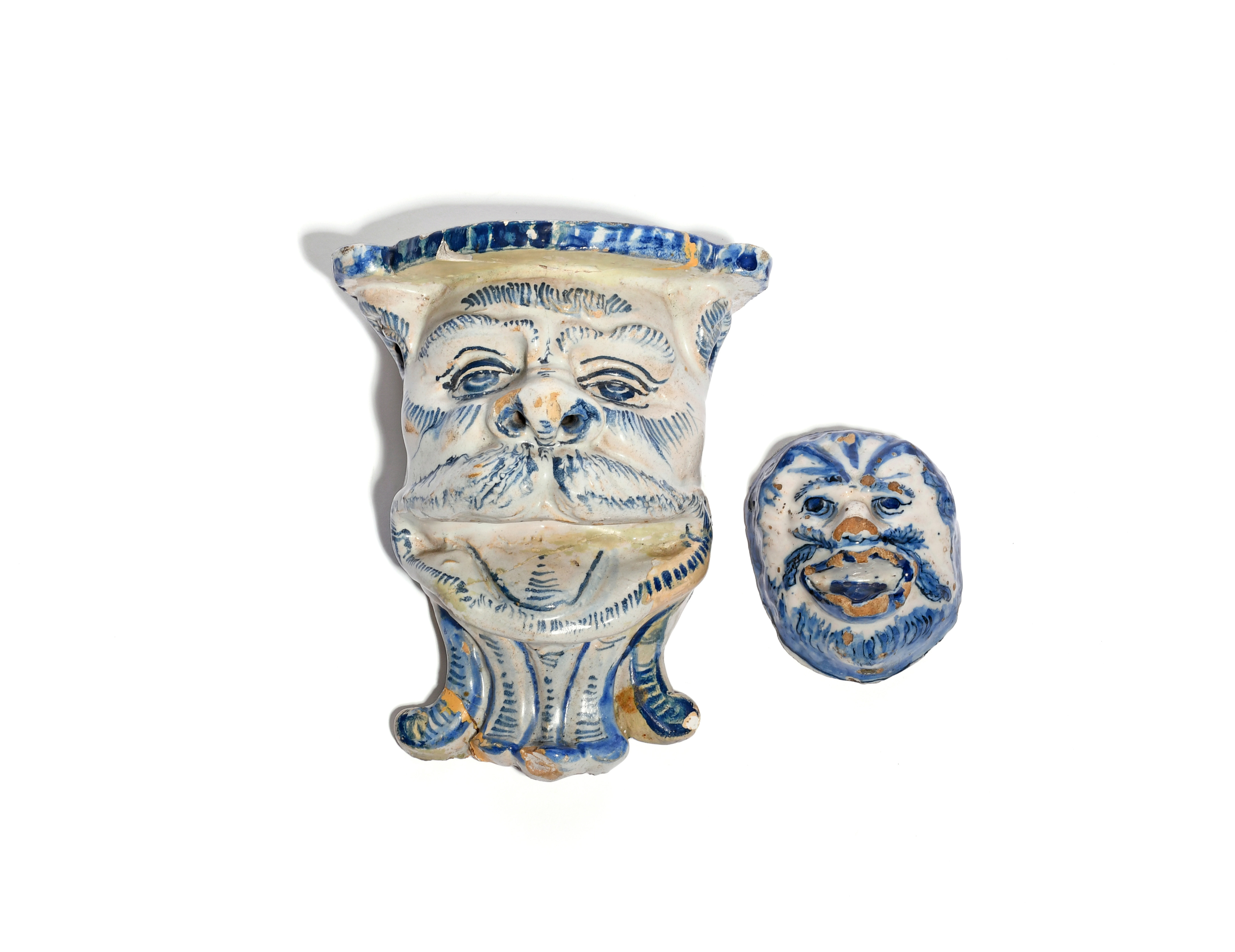 A Delft wall shelf 1st half 18th century, modelled as the face of mythical beast beneath a flattened