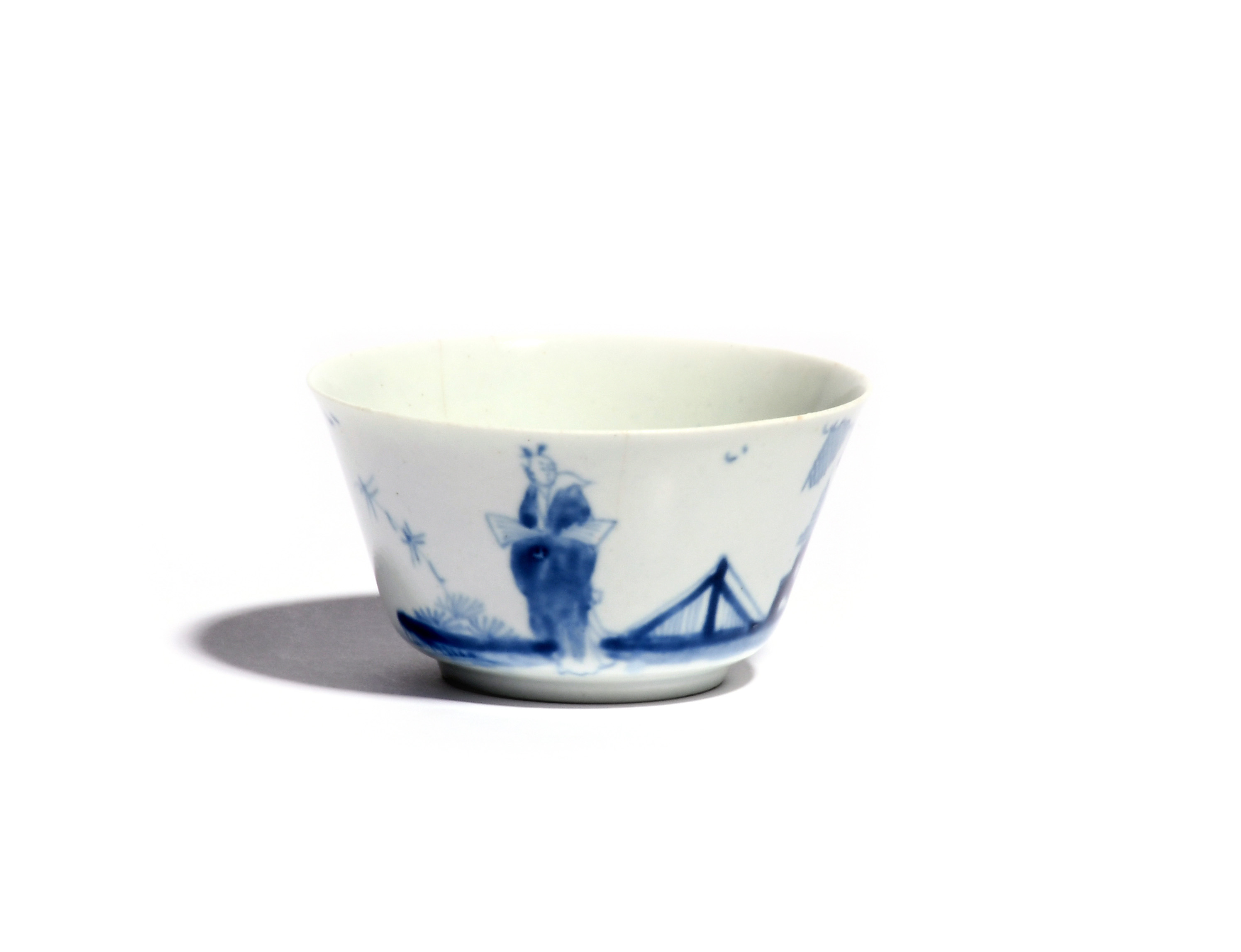 An early Worcester blue and white teabowl c.1753, the finely potted flared shape painted with the