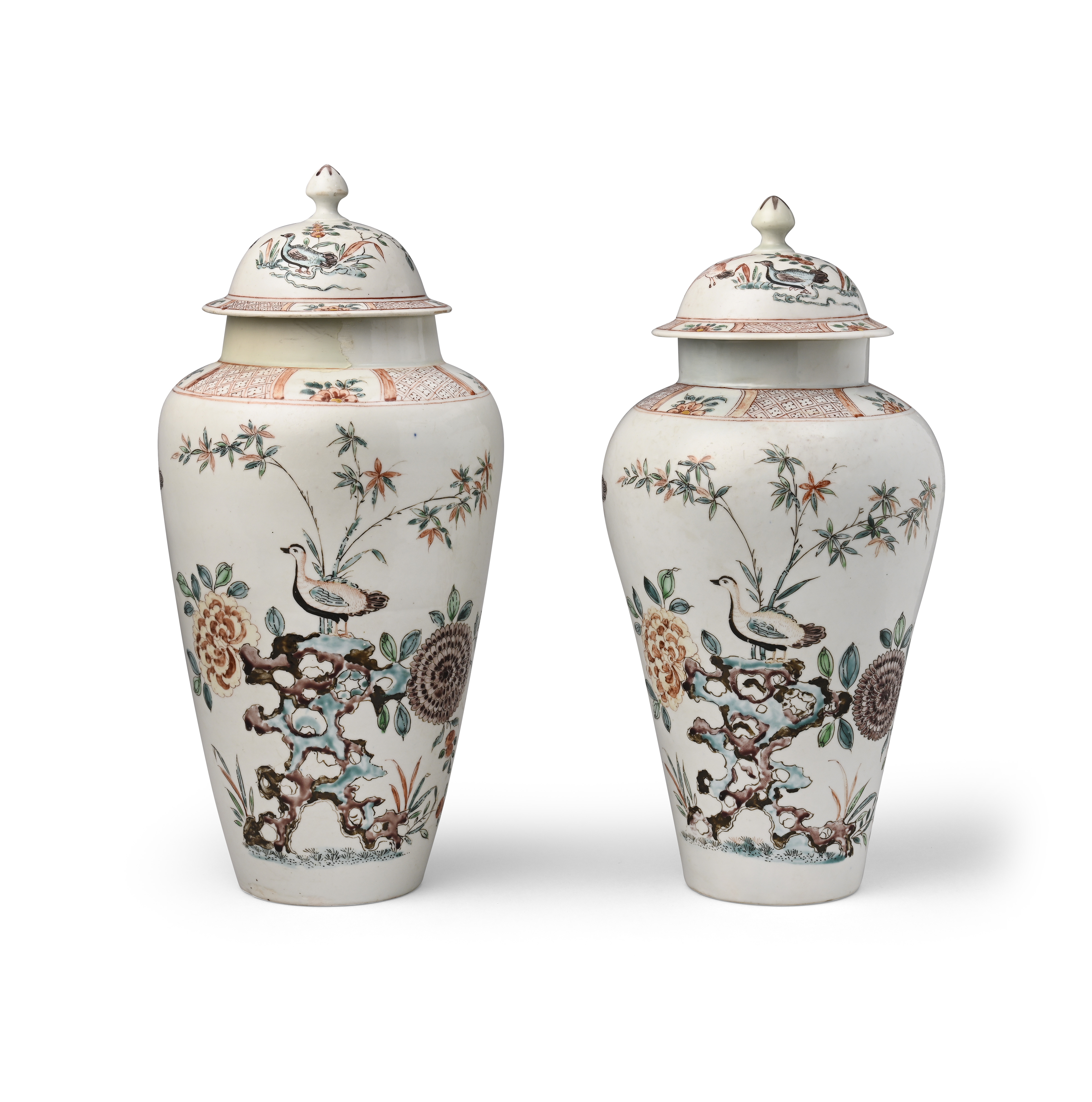 A near pair of rare Bow vases and covers c.1750, each painted with a duck standing atop holey
