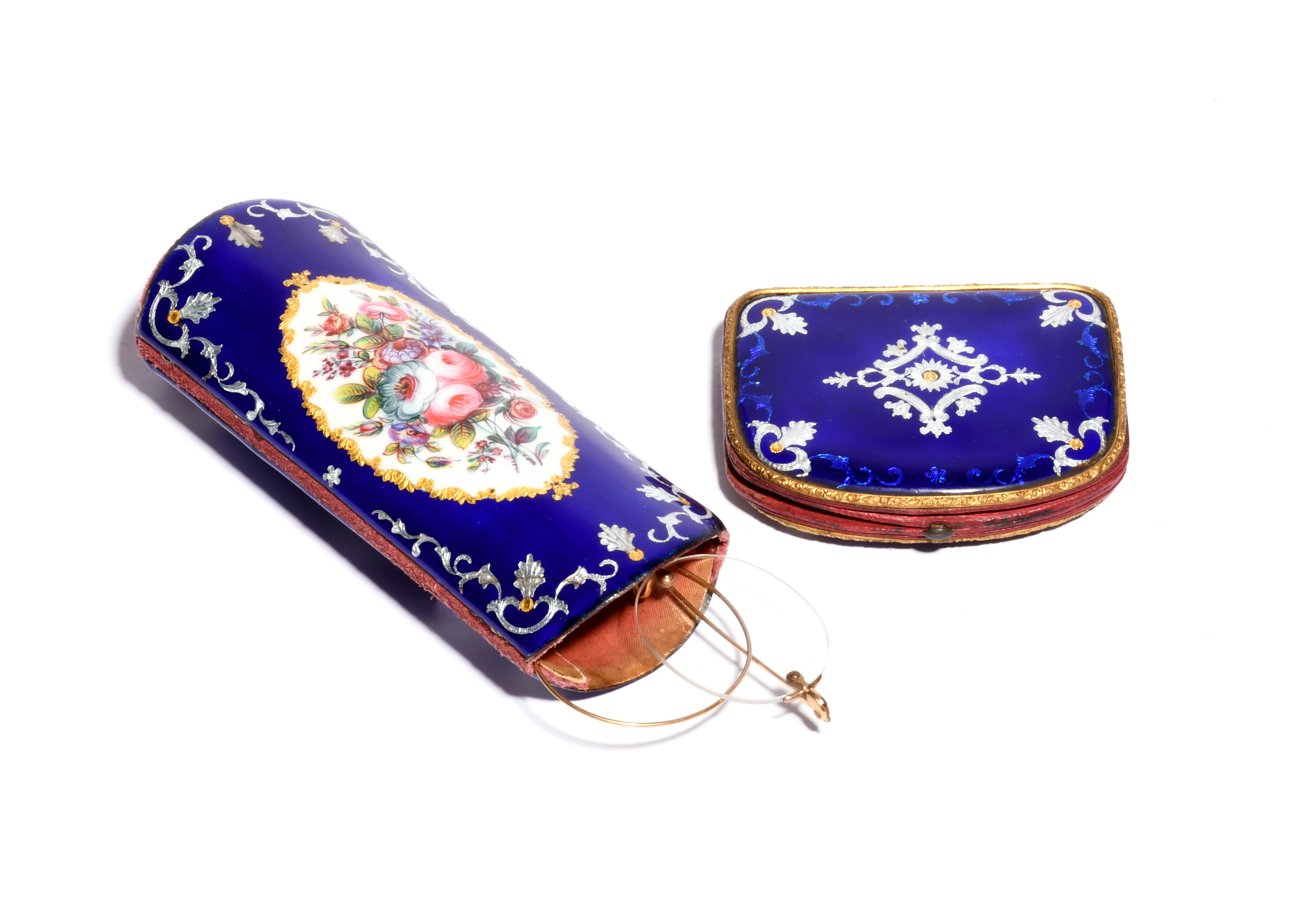 A French enamel purse and matching spectacles case 19th century, the case painted with a panel of