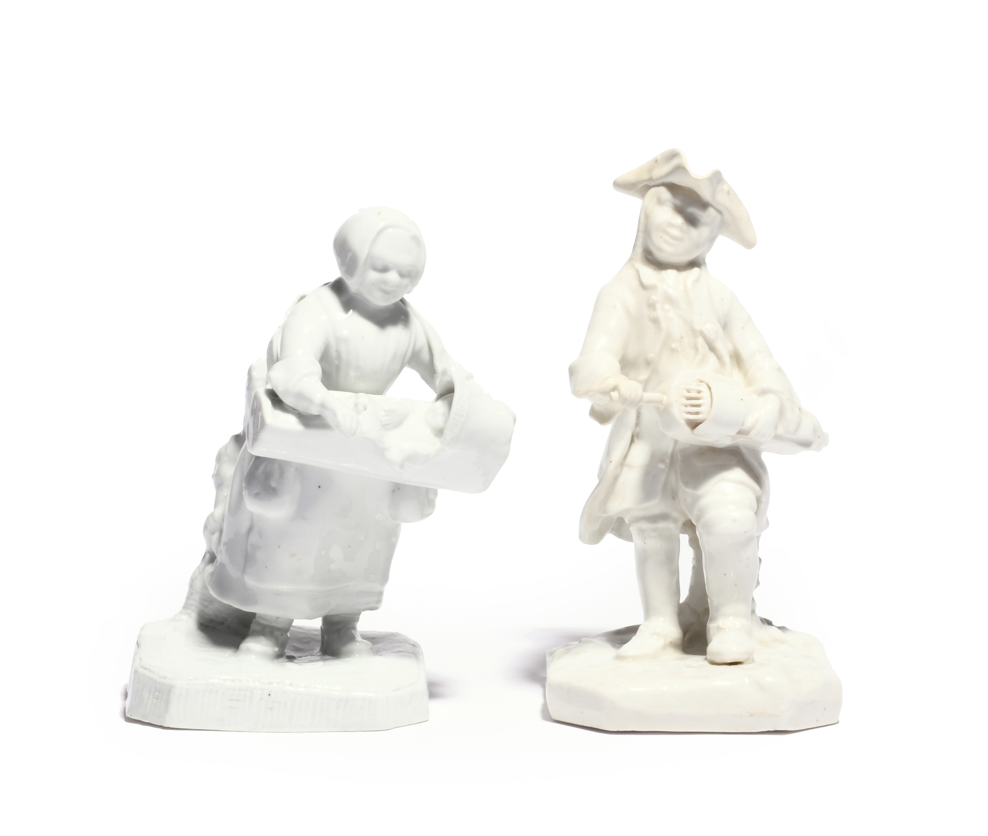 A rare matched pair of white-glazed Bow figures of street musicians c.1752, he standing and
