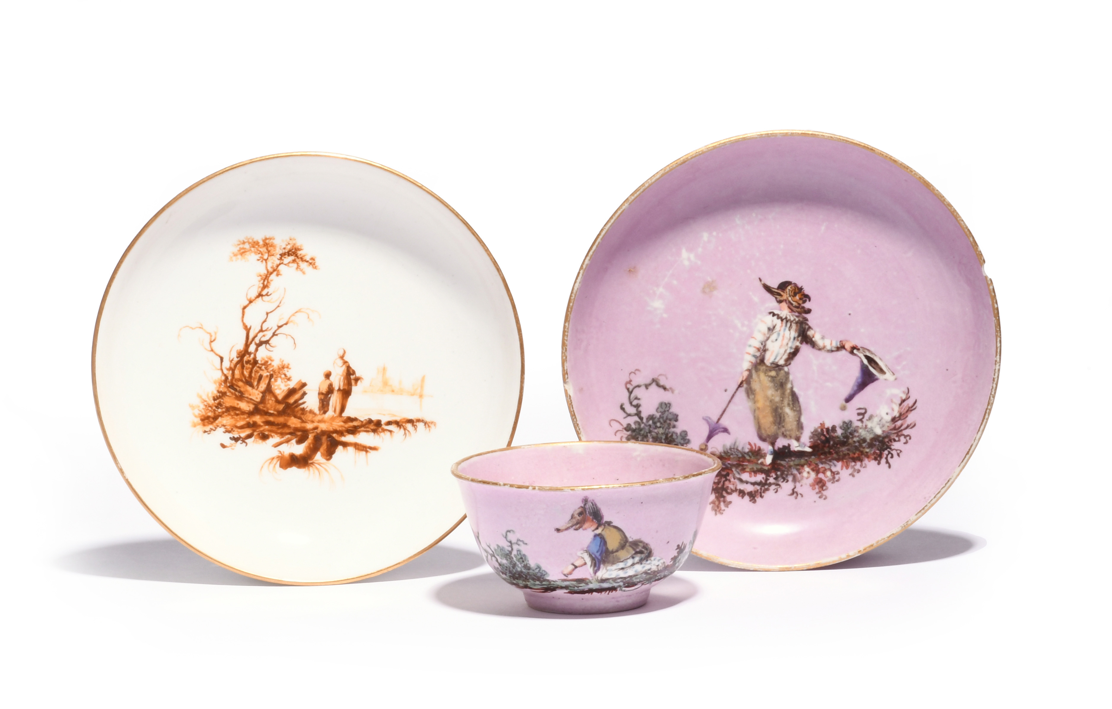 A Loosdrecht lilac ground teabowl and saucer c.1772-75, painted with masked figures from the