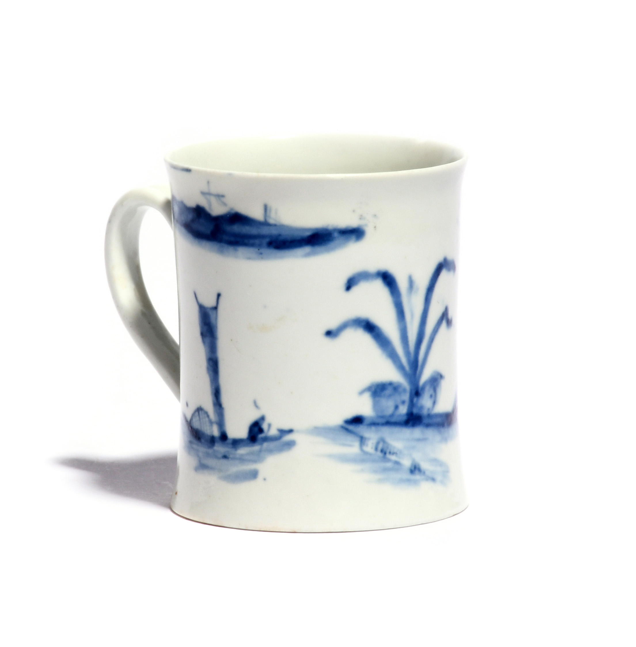 An early Worcester blue and white small mug c.1753-54, the slightly waisted form painted with the