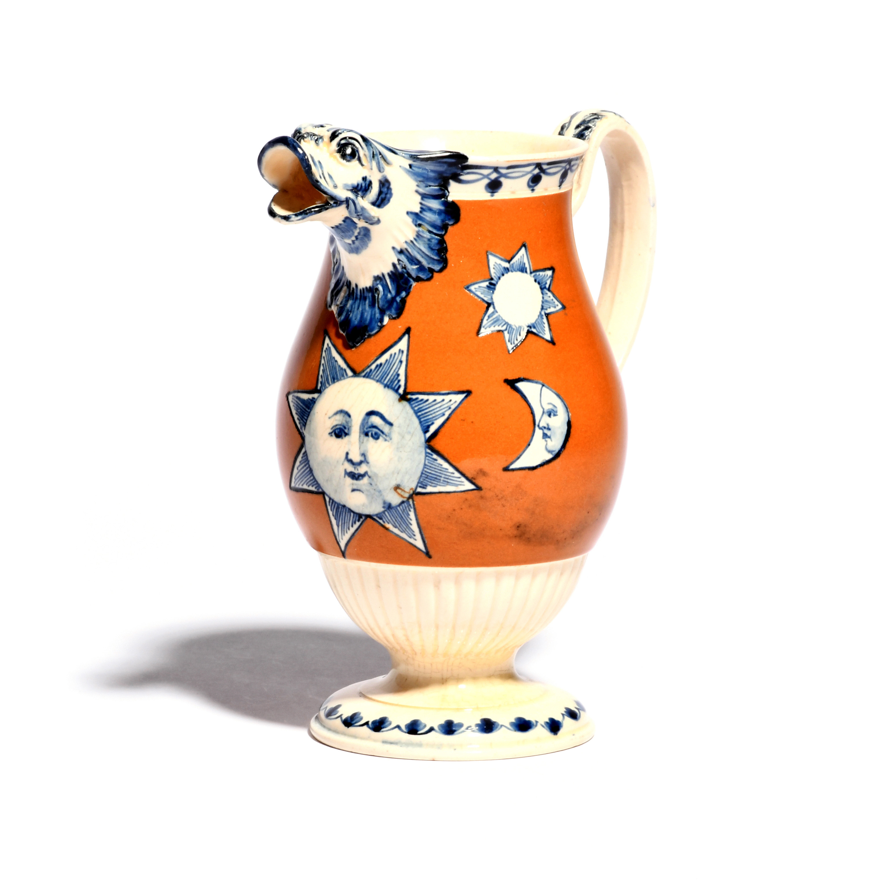 An unusual creamware jug c.1800, the baluster body painted with Masonic sun and moon symbols in blue