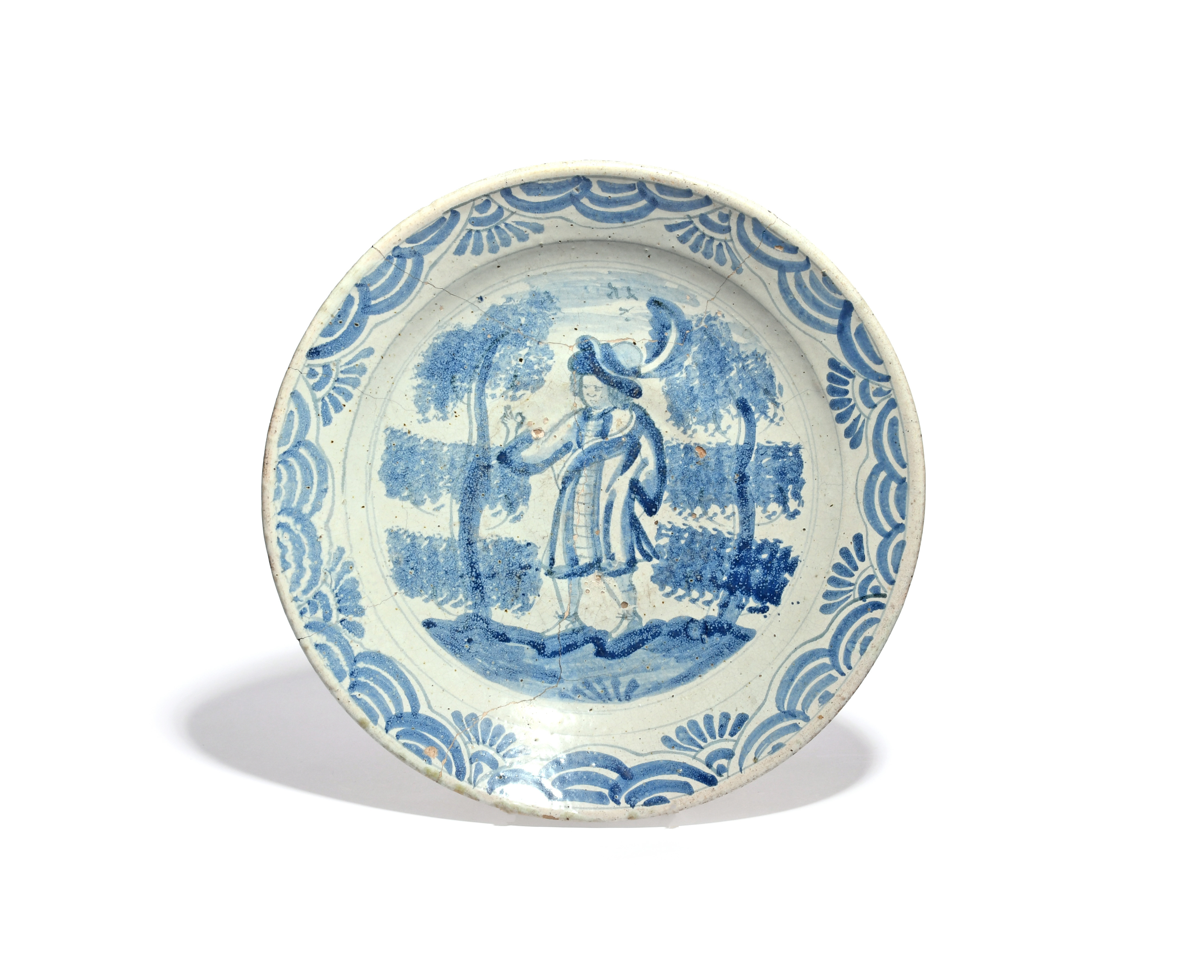 An early Brislington delftware charger c.1690, painted in blue with a European gentleman wearing a