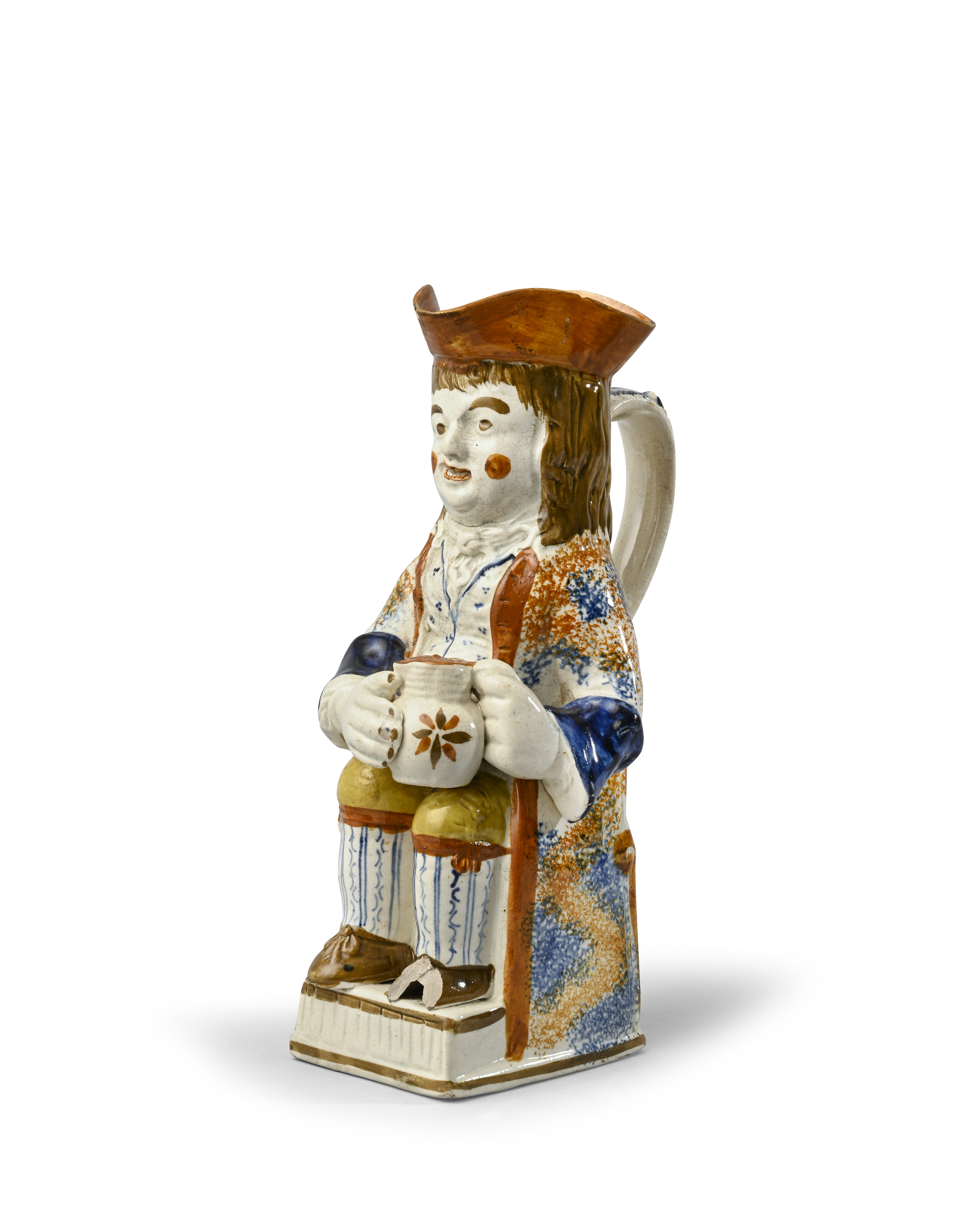 A rare Pratt ware Thin Boy toby jug c.1790-1800, seated with a patterned jug of ale resting on his