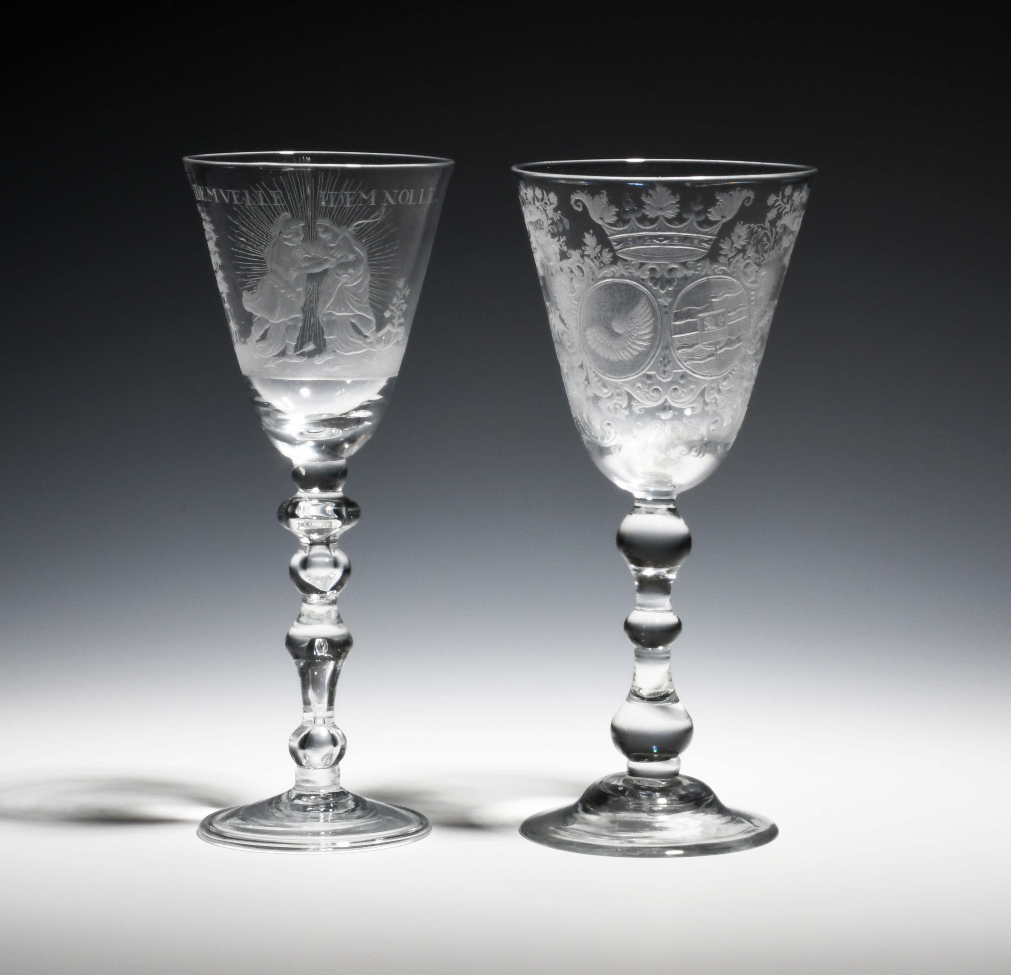 A Dutch-engraved armorial Marriage goblet c.1750, the rounded funnel bowl engraved with two oval