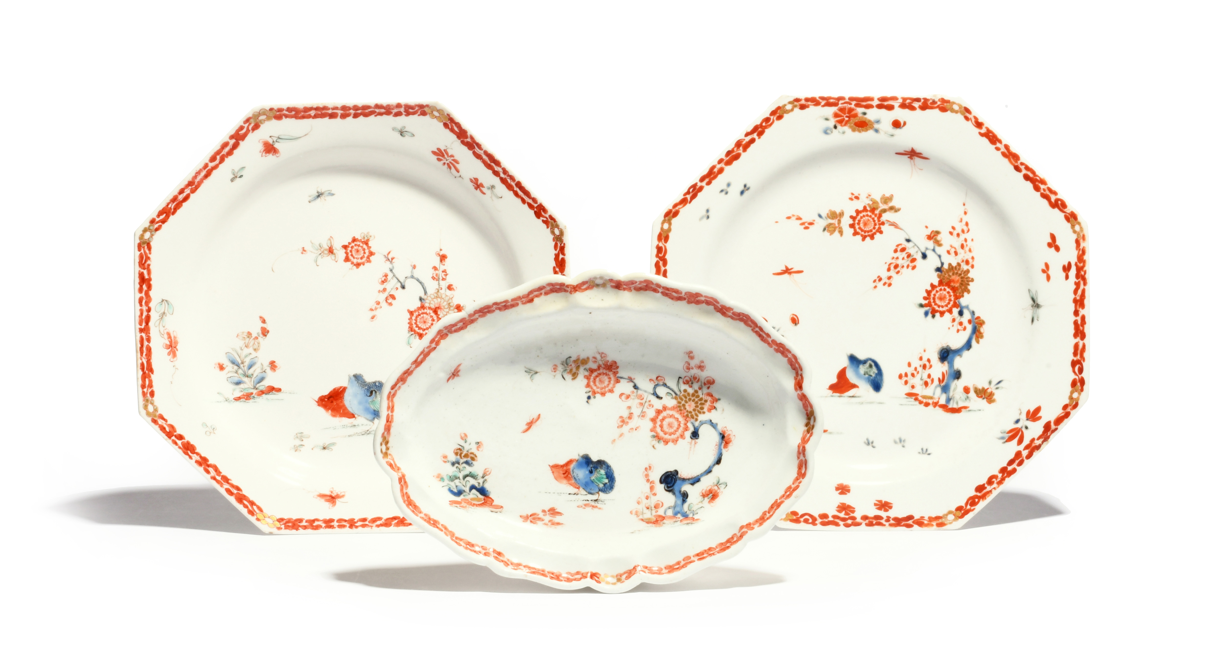 A pair of Bow octagonal plates and a small oval dish c.1755, all decorated in Kakiemon enamels