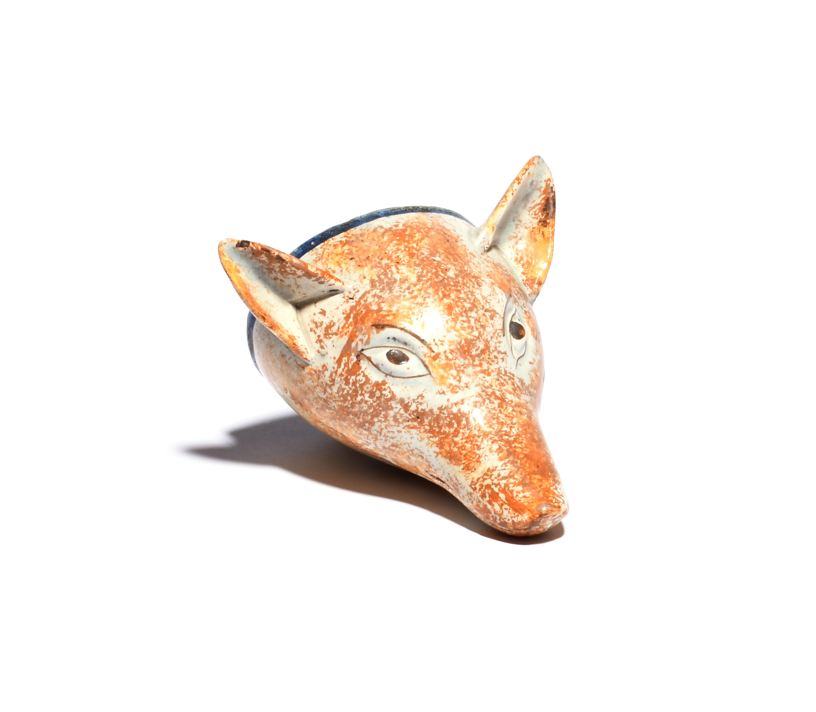 A large pearlware stirrup cup c.1800, modelled as the head of a fox, with ears pricked, sponged in