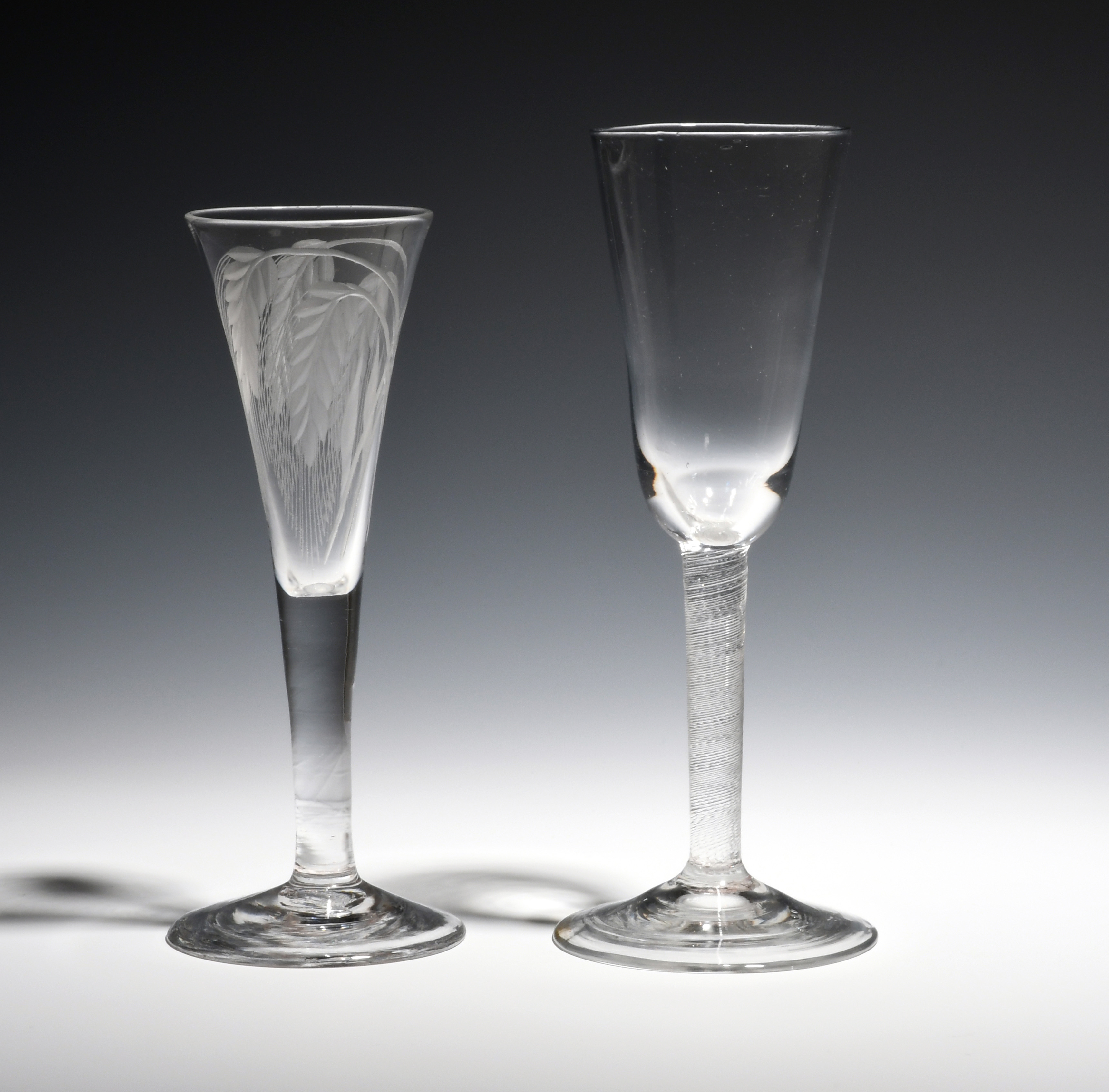 Two ale glasses c.1750-60, one with a drawn trumpet bowl engraved with two pairs of barley ears