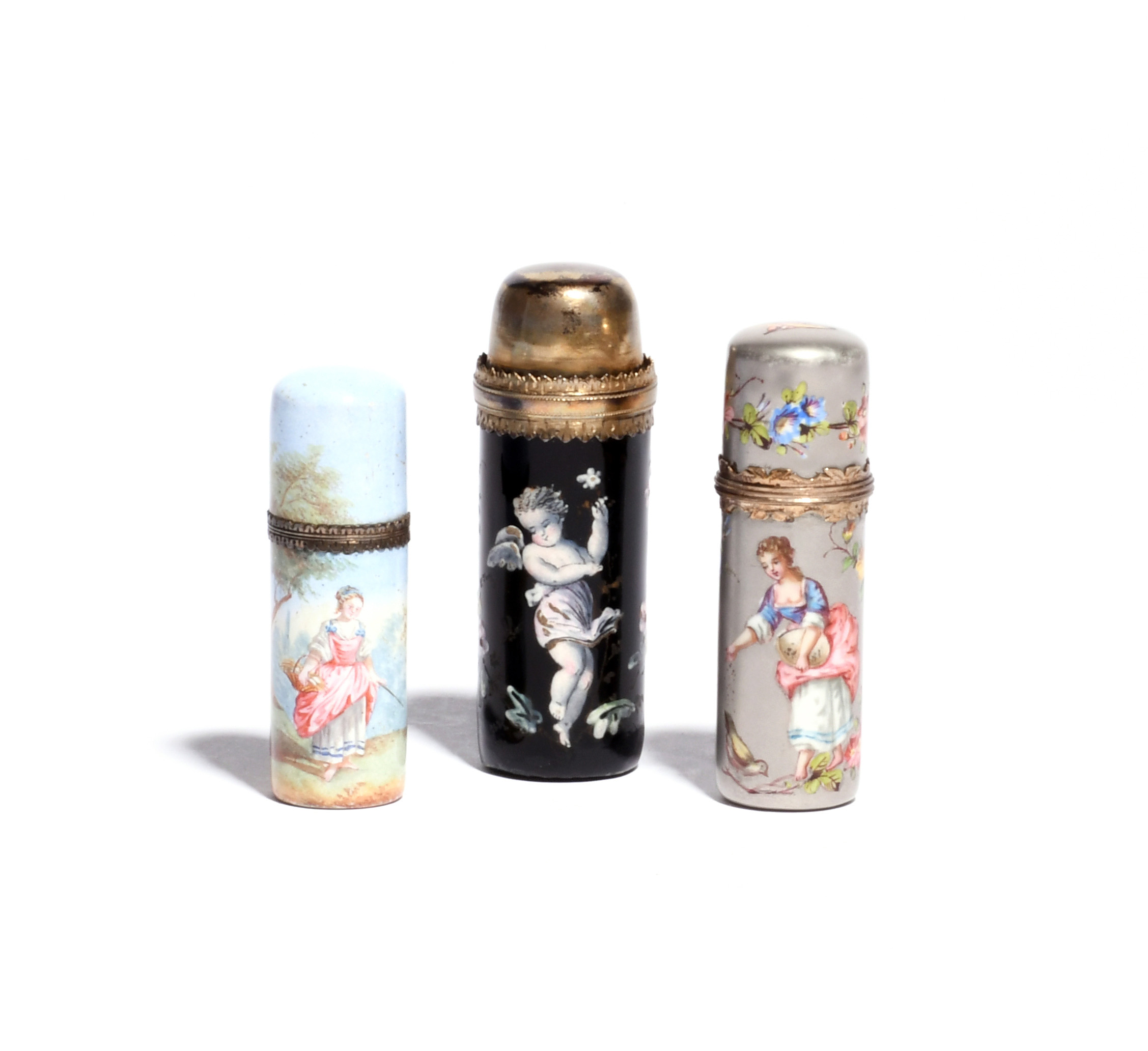 Three French enamel scent bottles 19th century, of cylindrical form, the largest painted with a