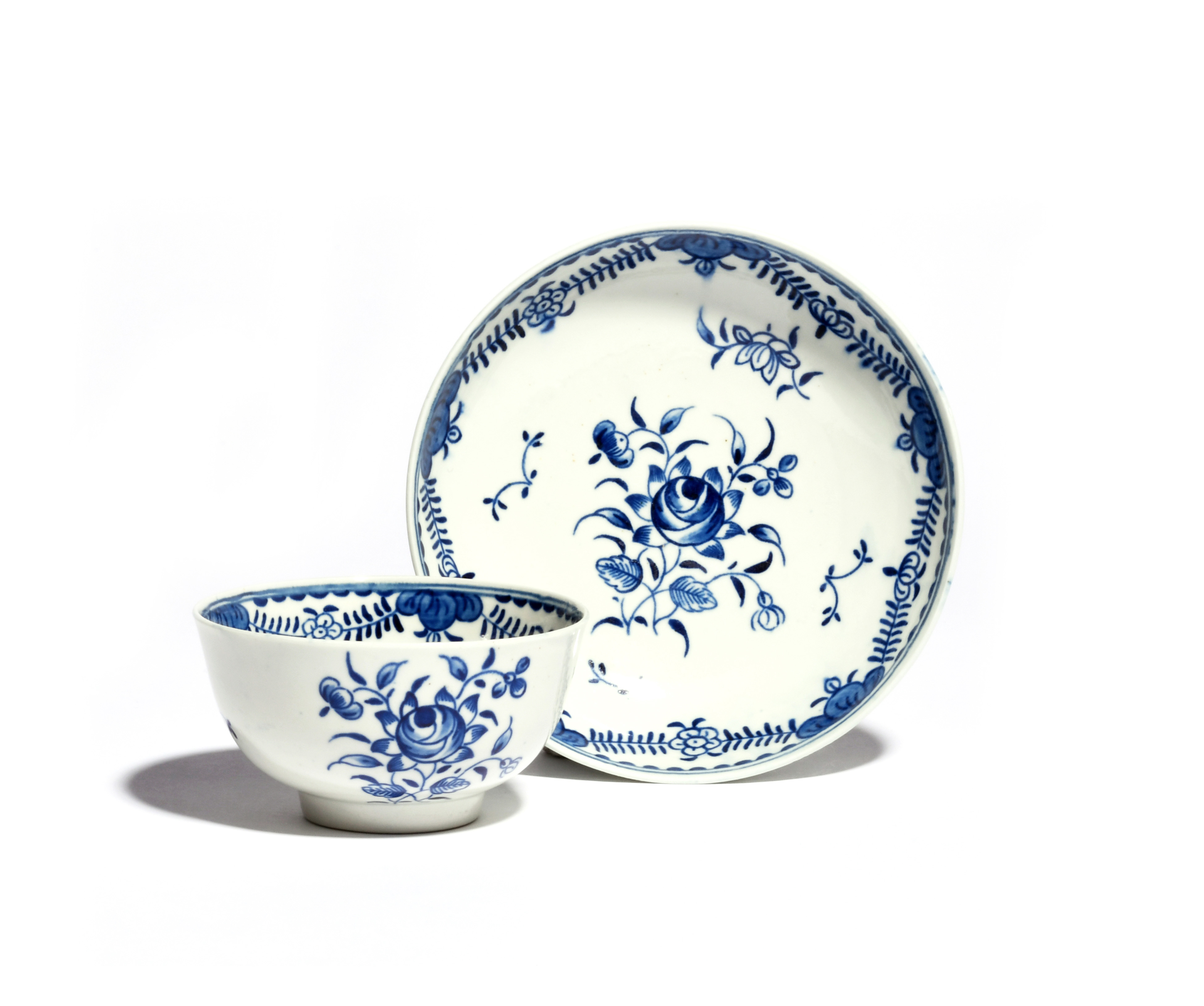 A rare Worcester blue and white teabowl and saucer c.1785, the generous forms painted with the