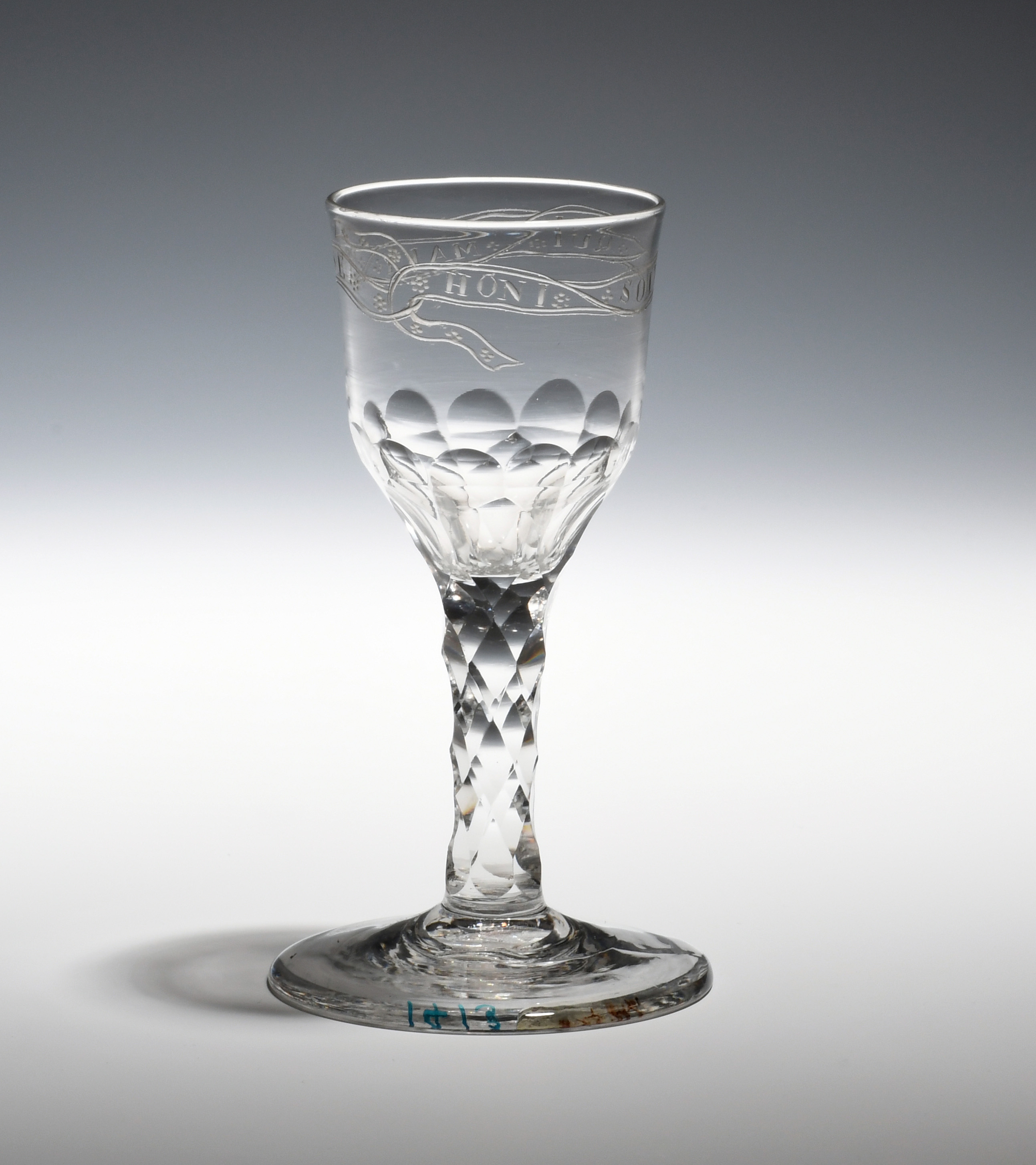 A wine glass c.1770, the ogee bowl engraved with 'Honi Soi Qui Mal Y Pense', the motto of the