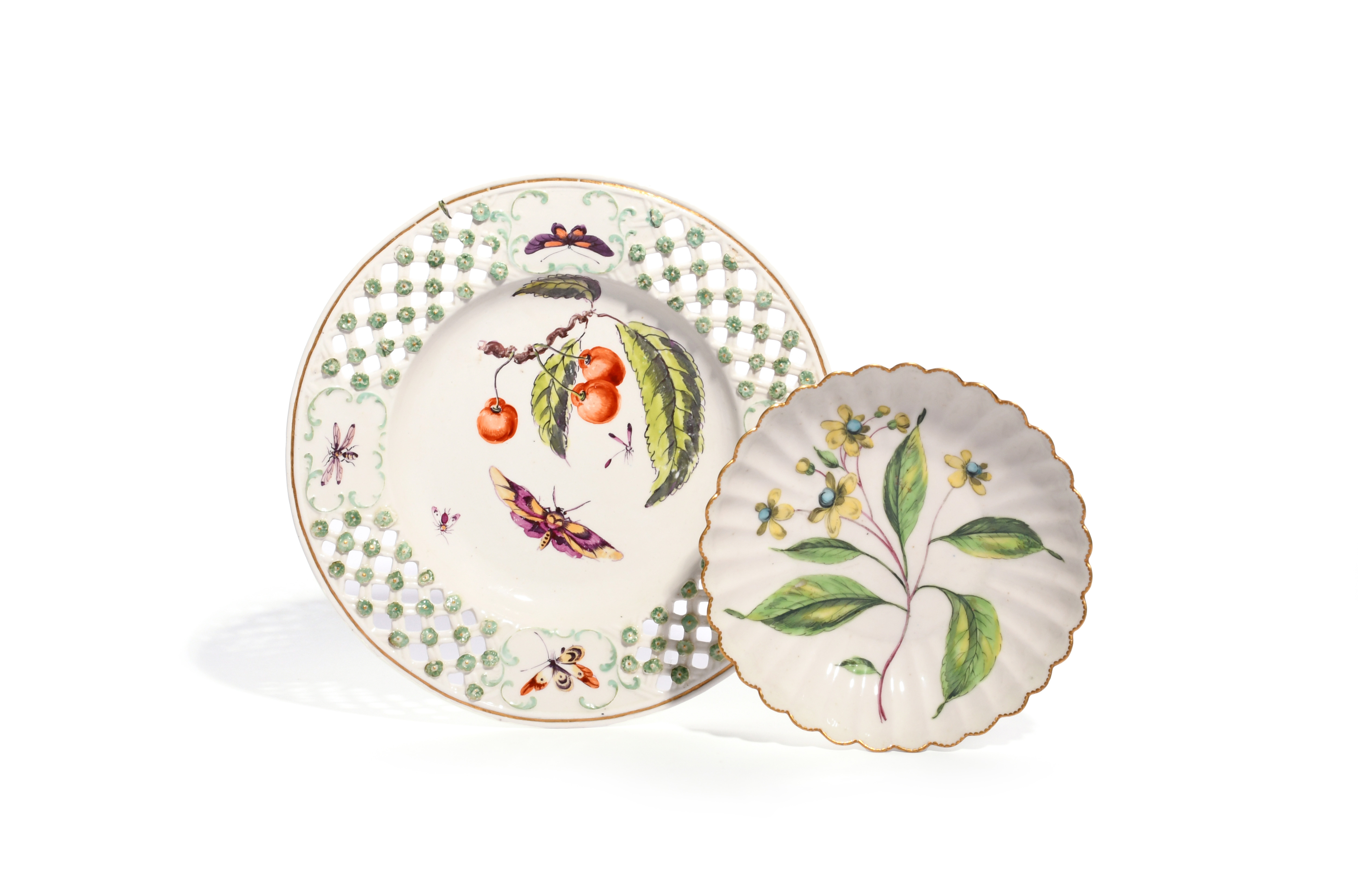 A Derby plate c.1765, painted with a large fruiting cherry spray, colourful moths and other insects,