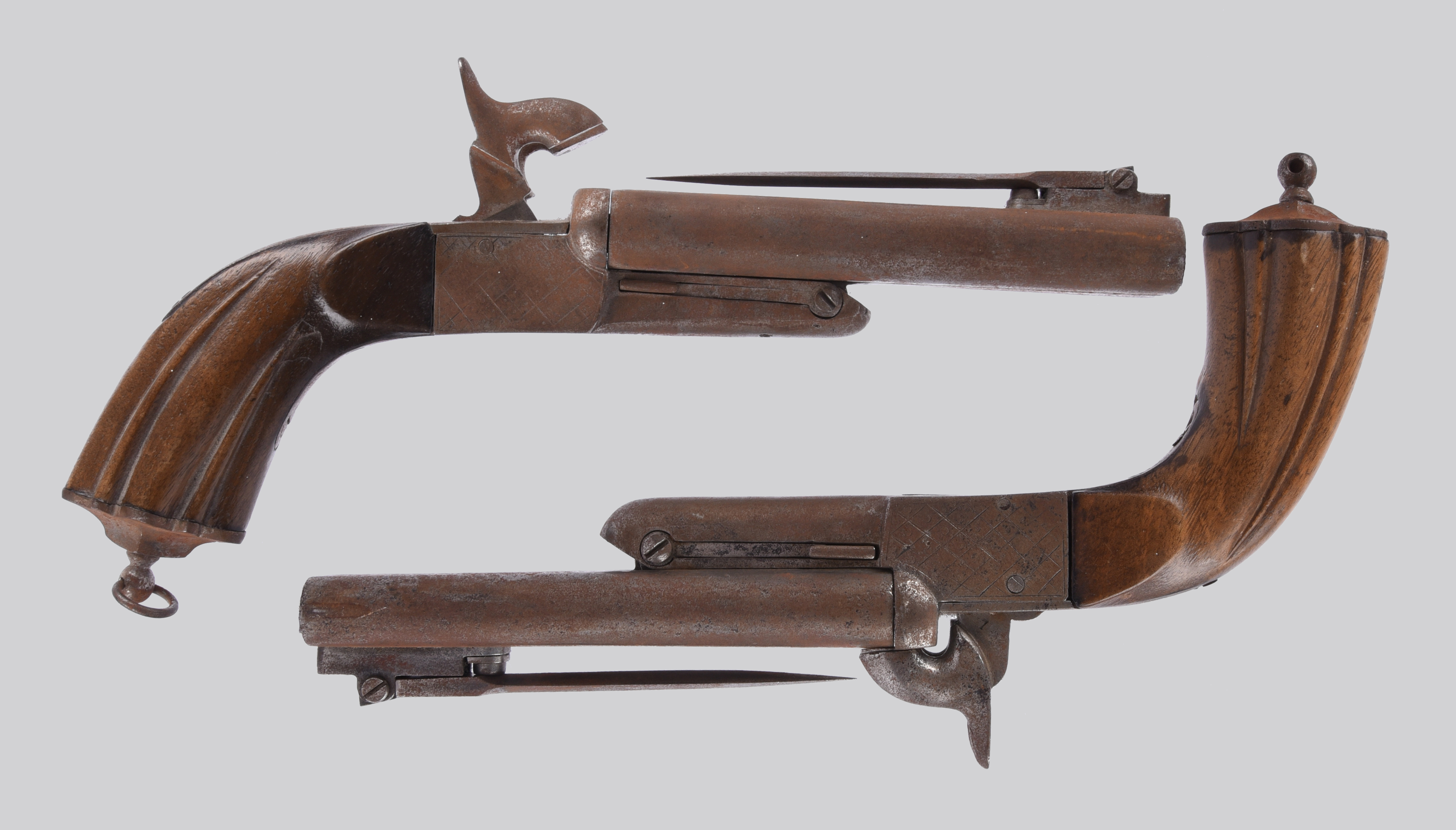 A near pair (or graduated set) of continental pinfire double pistols, each with folding bayonet, box