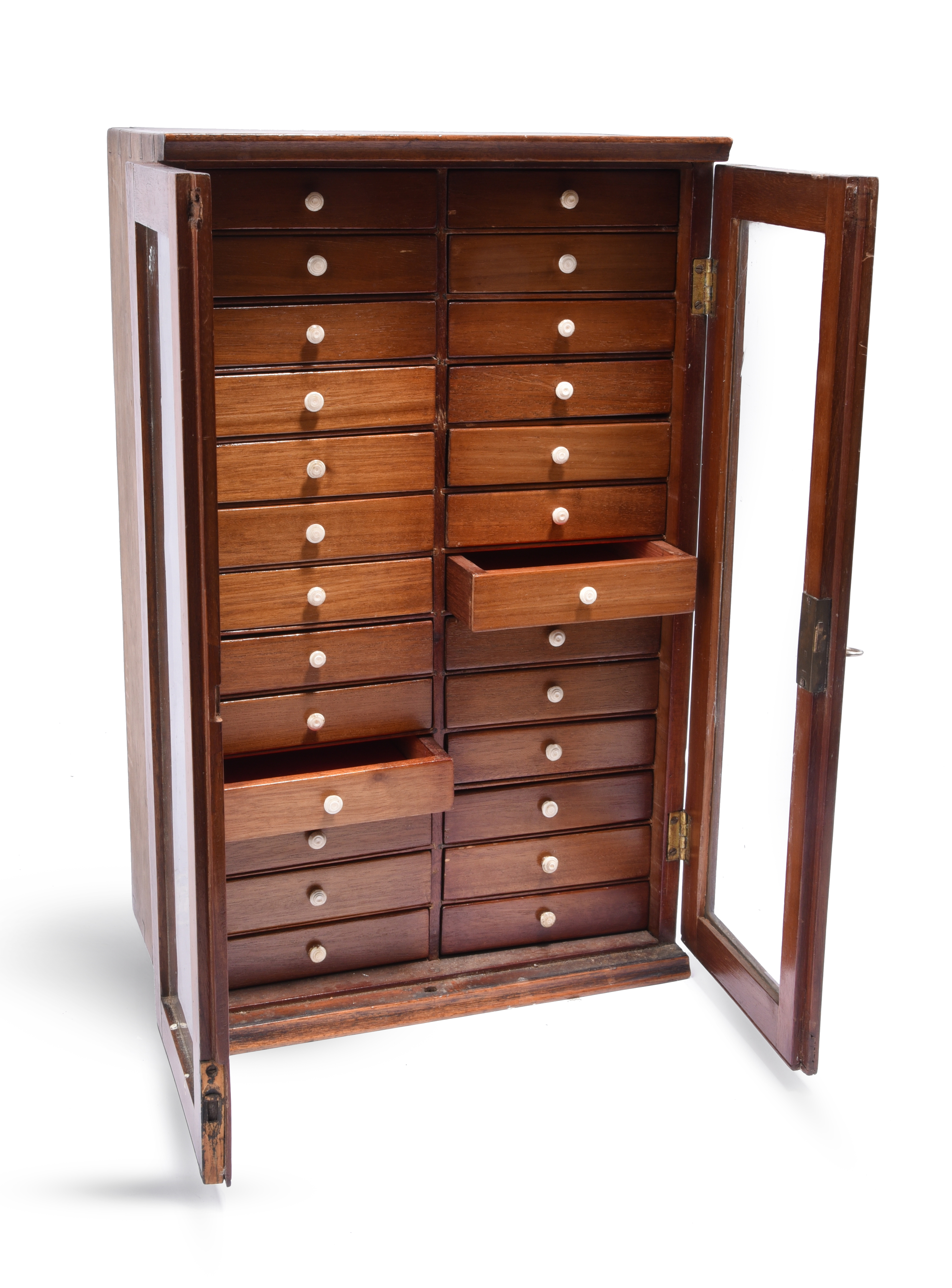 A late 19th/early 20th century collectors cabinet, 26 small drawers in two columns enclosed by