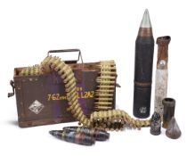 A small collection of inert munitions and associated items, including: a Vickers machine gun
