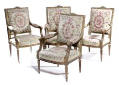 A SET OF FOUR FRENCH GILTWOOD FAUTEUIL IN LOUIS XVI STYLE 19TH CENTURY each with a padded back, seat