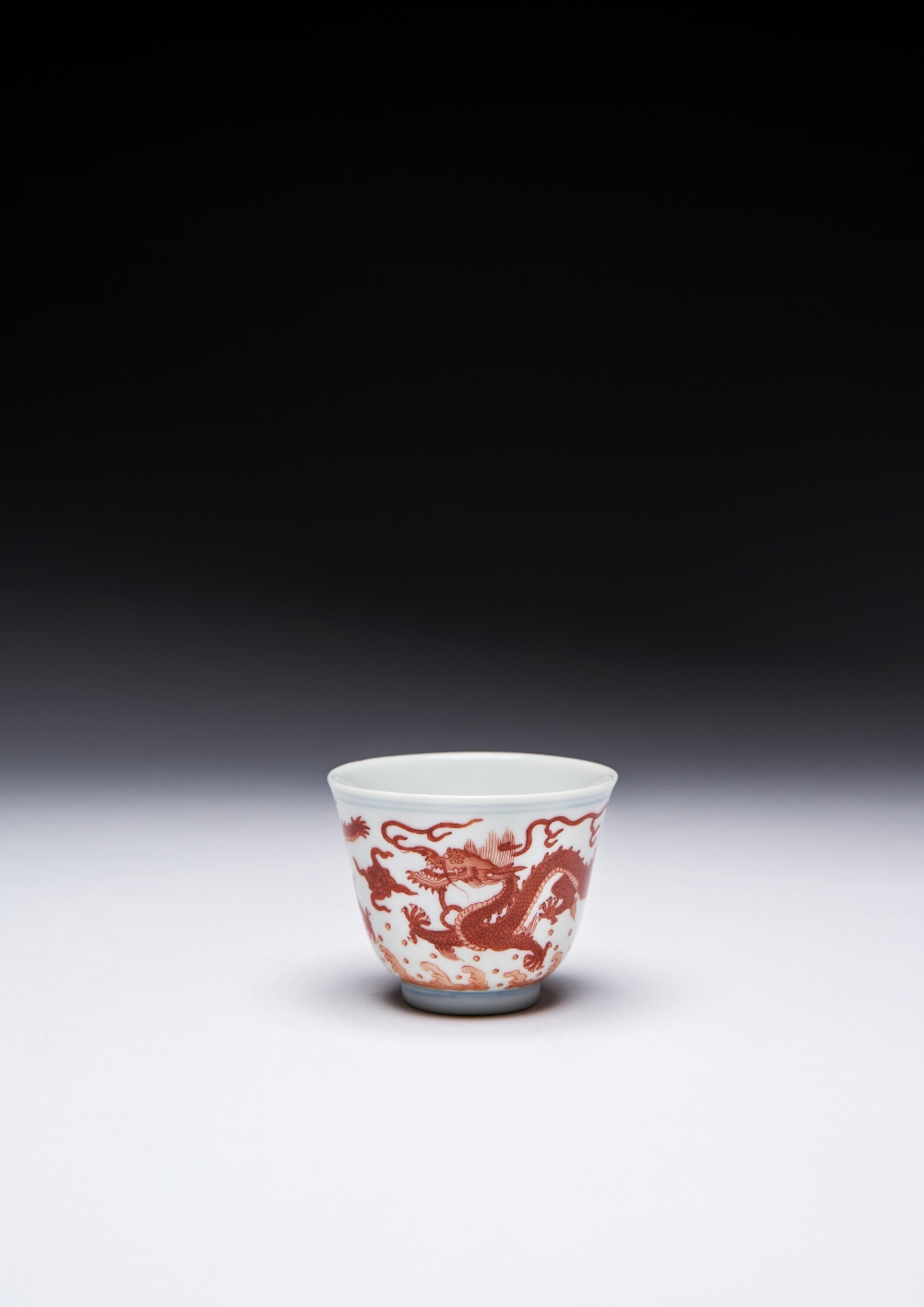 A CHINESE IMPERIAL IRON-RED 'DRAGON' WINE CUP SIX CHARACTER DAOGUANG MARK AND OF THE PERIOD 1821-