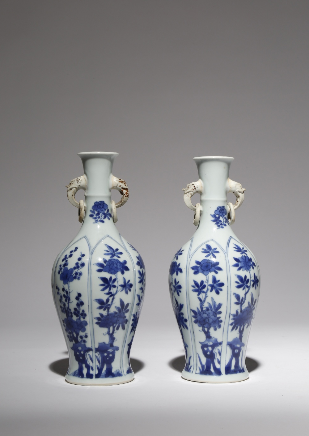 A PAIR OF CHINESE BLUE AND WHITE MOULDED VASES KANGXI 1662-1722 The ovoid bodies moulded with tall