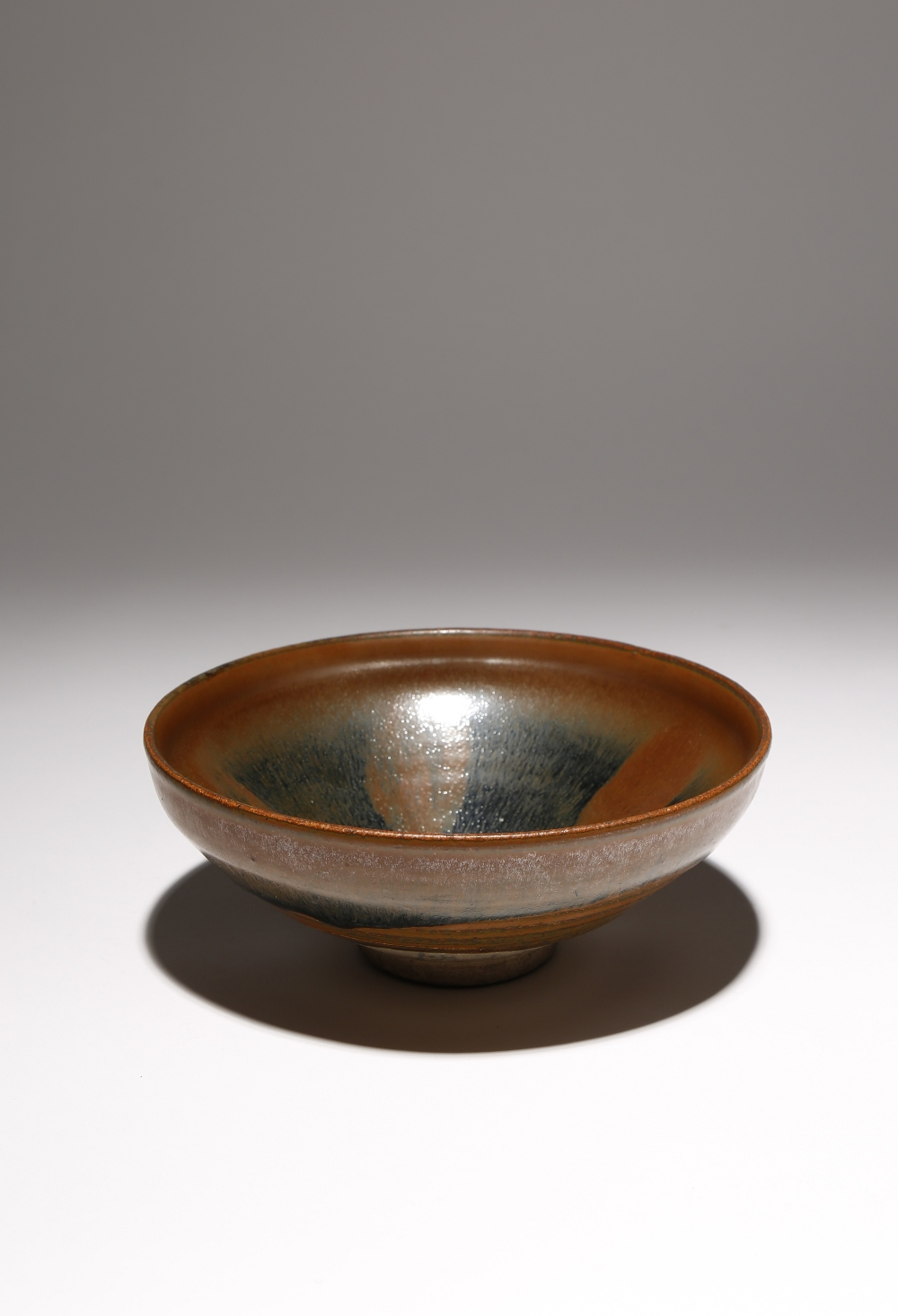 A CHINESE JIAN BOWL SONG DYNASTY Decorated in a 'hare's fur' glaze with brown streaks draining