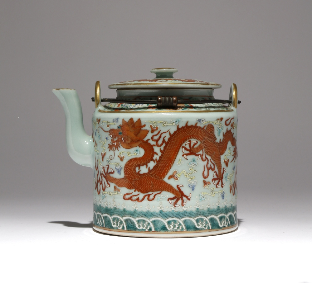 A CHINESE FAMILLE ROSE CELADON-GROUND 'DRAGON' TEAPOT AND COVER PROBABLY GUANGXU The cylindrical