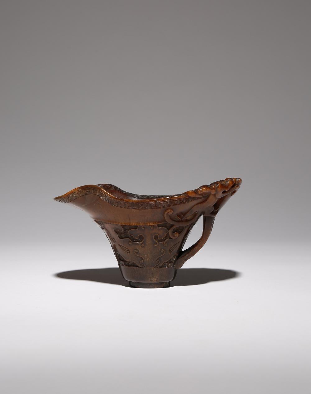 λ A CHINESE ARCHAISTIC RHINOCEROS HORN 'CHILONG' LIBATION CUP 17TH/18TH CENTURY The flared body - Image 2 of 3
