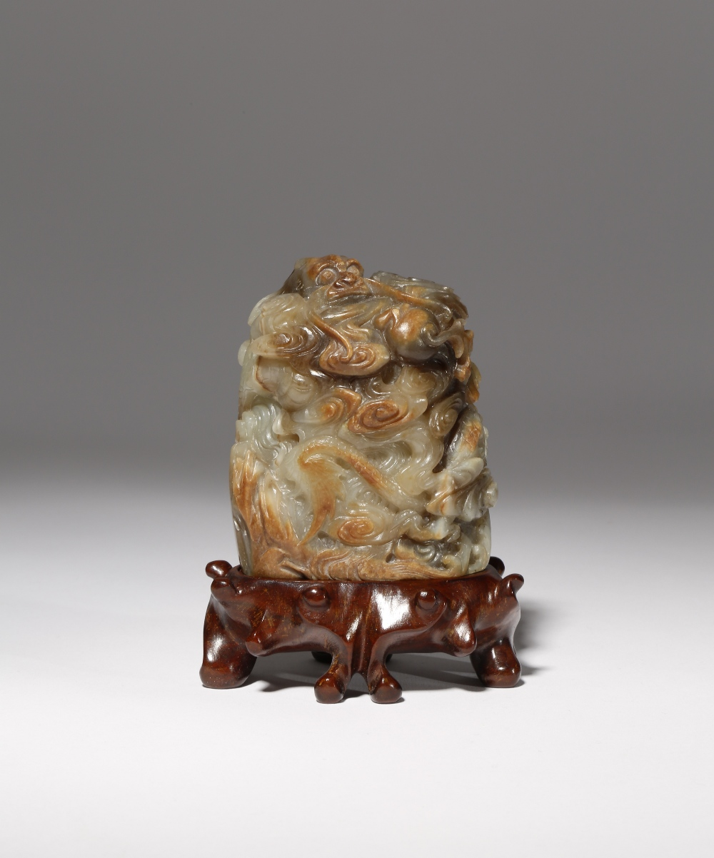 A CHINESE BROWN AND CELADON JADE 'DRAGON' FINIAL MING DYNASTY Carved with a scaly dragon writhing