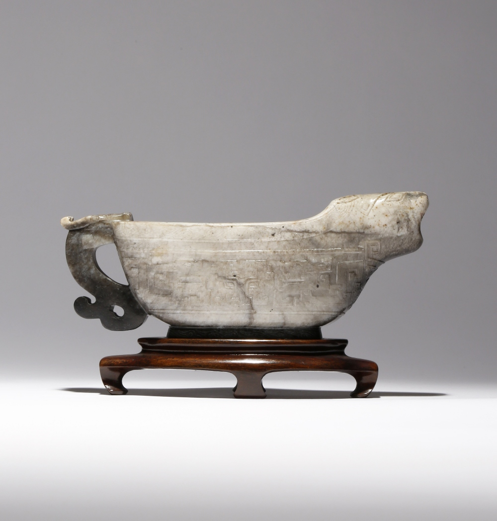A CHINESE ARCHAISTIC BLACK AND WHITE JADE POURING VESSEL, YI 18TH CENTURY Decorated in low relief to - Image 2 of 2