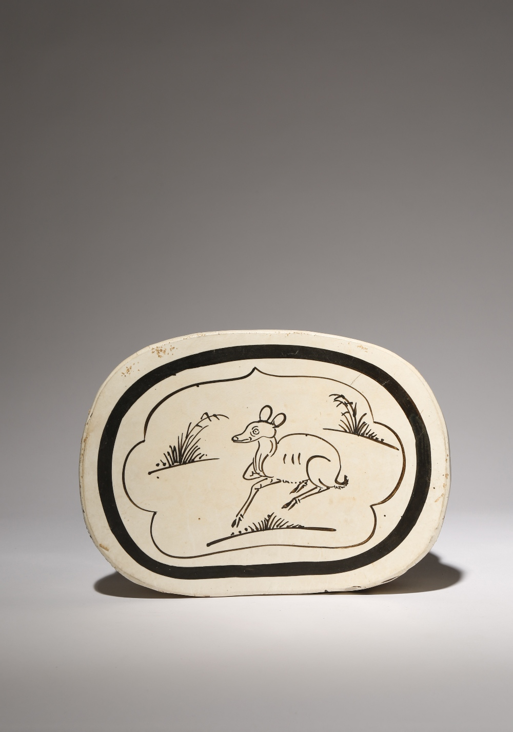 A CHINESE CIZHOU 'DEER' PILLOW PROBABLY SONG DYNASTY Painted in black with a panel enclosing a