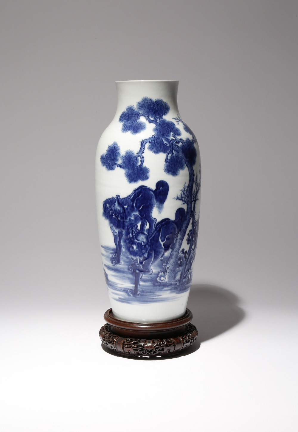 A CHINESE BLUE AND WHITE 'LION DOGS' OVOID VASE 18TH CENTURY The tall body rising to a short