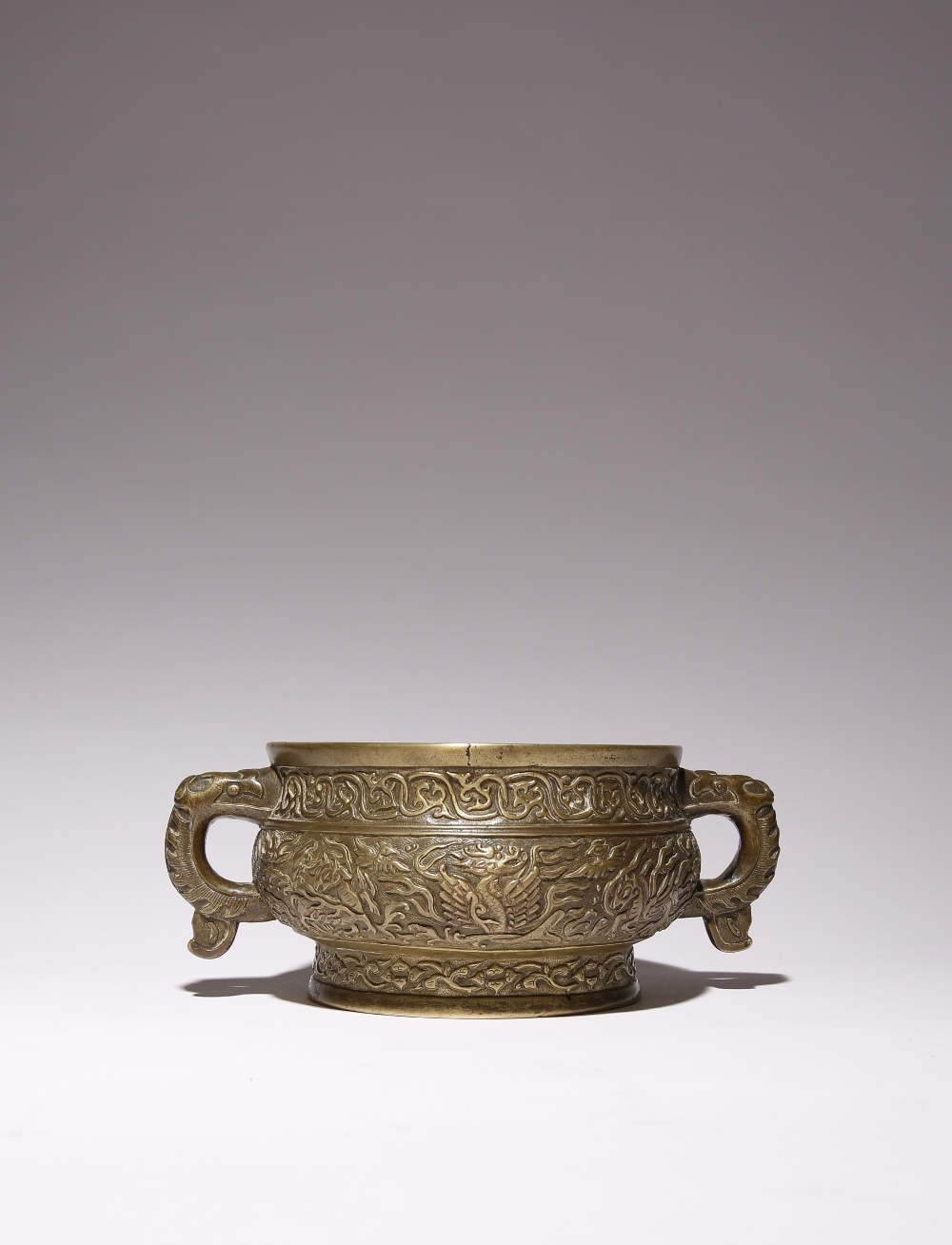 A CHINESE BRONZE 'MYTHICAL BEASTS' INCENSE BURNER 17TH/18TH CENTURY Decorated in relief with a
