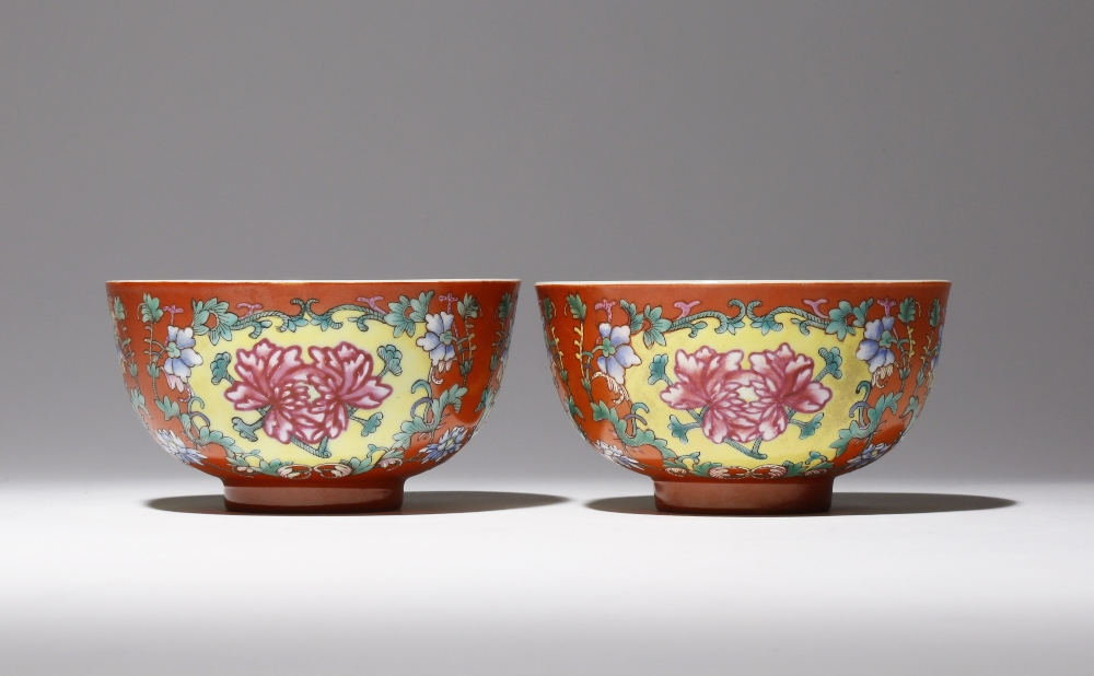 A PAIR OF CHINESE FAMILLE ROSE CORAL-GROUND 'PEONY' BOWLS SIX CHARACTER XUANTONG MARKS AND OF THE