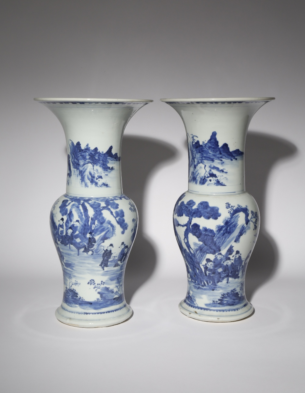 A NEAR PAIR OF CHINESE BLUE AND WHITE YEN YEN VASES 19TH CENTURY Each painted with a continuous