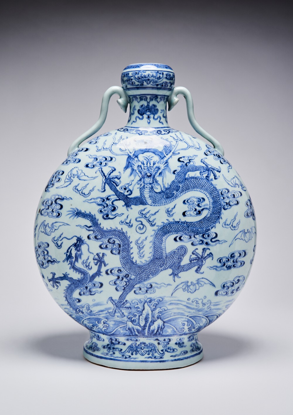 A MASSIVE CHINESE BLUE AND WHITE 'DRAGON' MOONFLASK QIANLONG 1736-95 Painted to each side with a