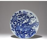 A LARGE CHINESE BLUE AND WHITE 'PHOENIX AND PEONY' DISH KANGXI 1662-1722 The deep sides rising