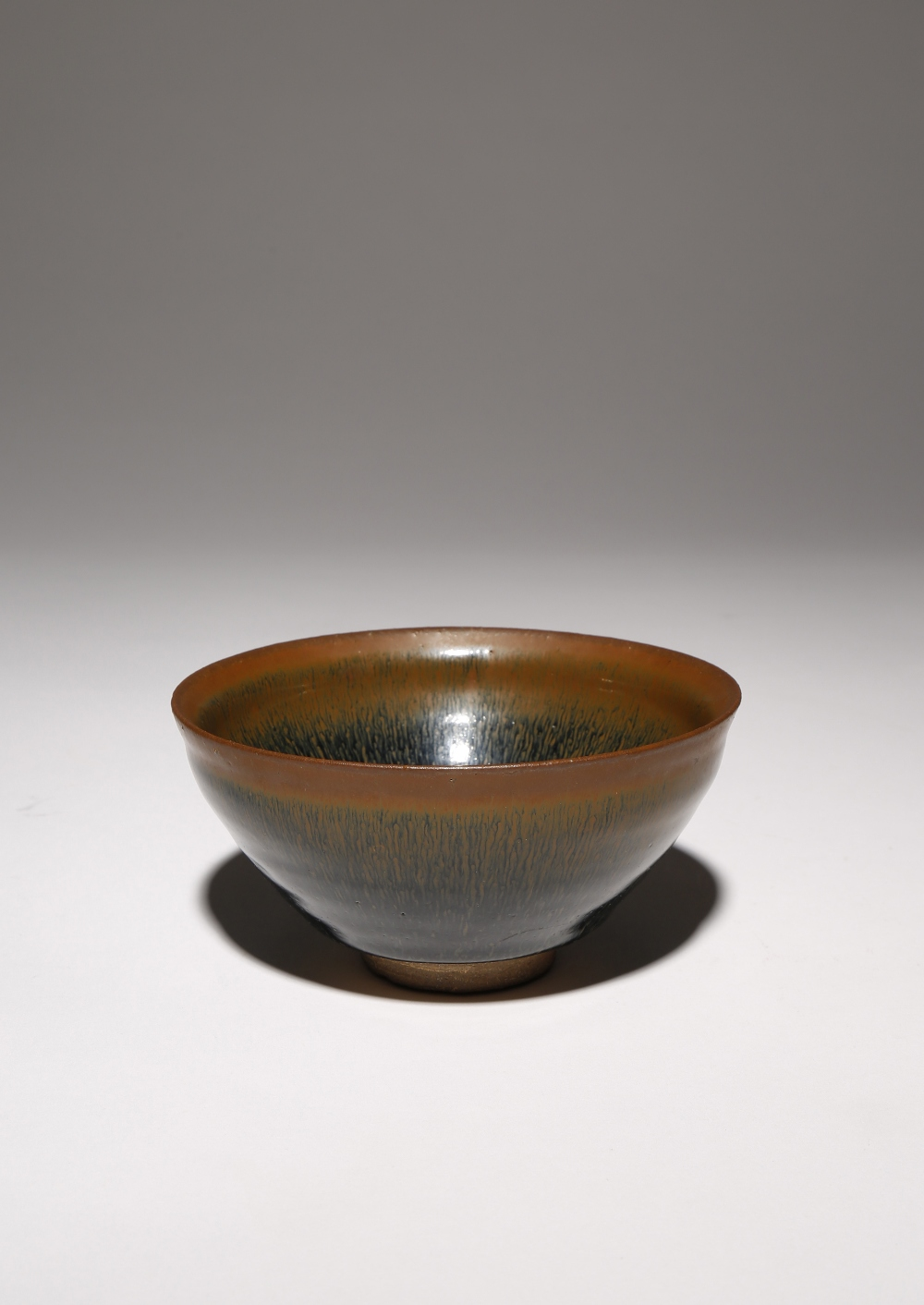 A CHINESE JIAN BOWL SONG DYNASTY The deep conical body decorated in a thick 'hare's fur' glaze, with