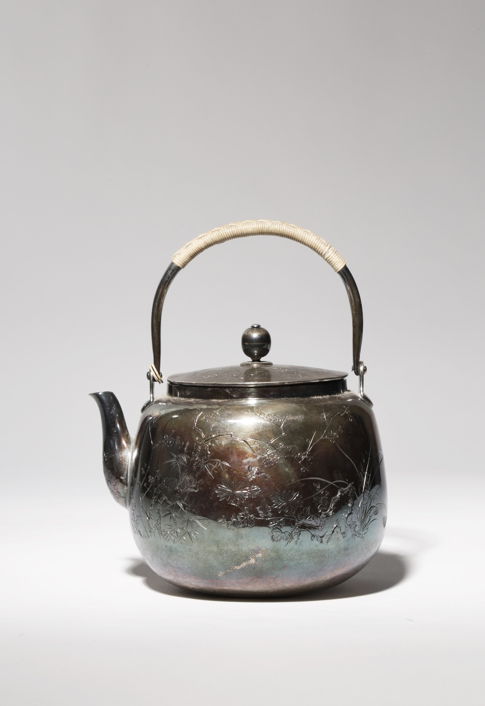 A JAPANESE SILVER TETSUBIN MEIJI OR TAISHO PERIOD, 19TH OR 20TH CENTURY The bulbous body decorated