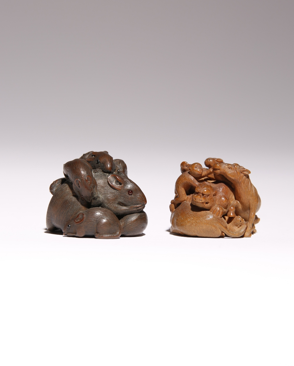 TWO JAPANESE WOOD NETSUKE OF ANIMALS MEIJI PERIOD, 19TH CENTURY The first intricately carved as