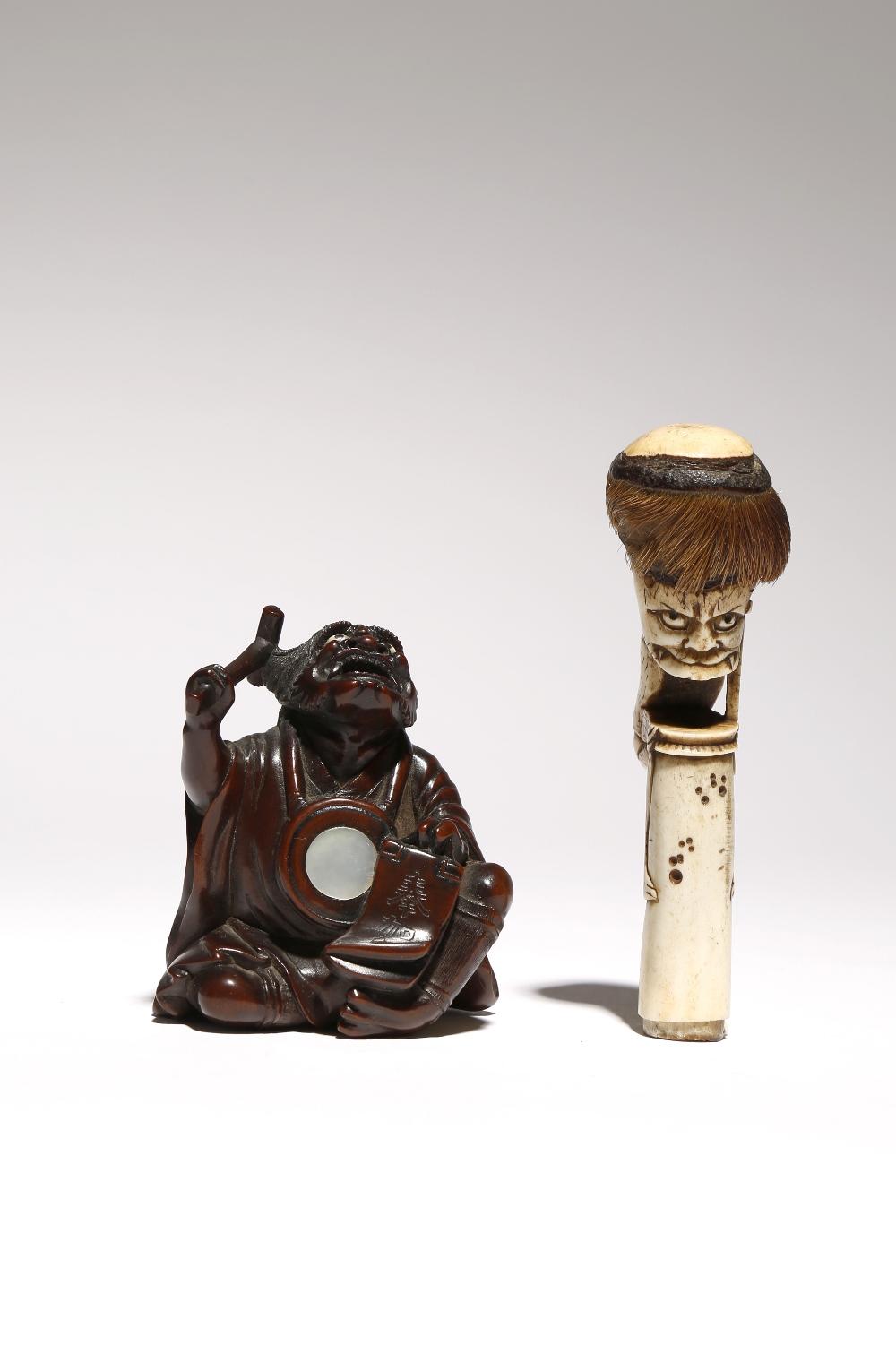 A JAPANESE WOOD OKIMONO OF AN ONI NEMBUTSU MEIJI PERIOD, 19TH CENTURY The repentant demon wearing